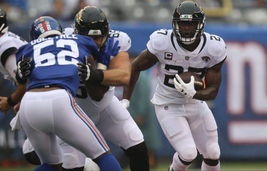 Leonard Fournette, of the Jaguars runs the ball against the Giants. Sunday, September 9, 2018