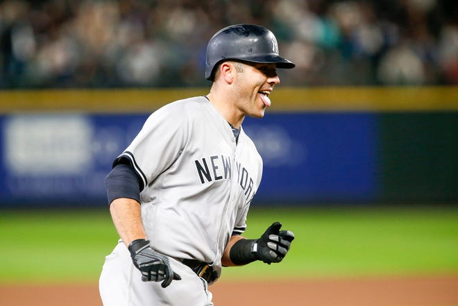 Sep 8, 2018; Seattle, WA, USA; New York Yankees catcher Austin Romine (28) reacts as he rounds the bases after hitting a solo homer against the Seattle Mariners during the seventh inning at Safeco Field.
