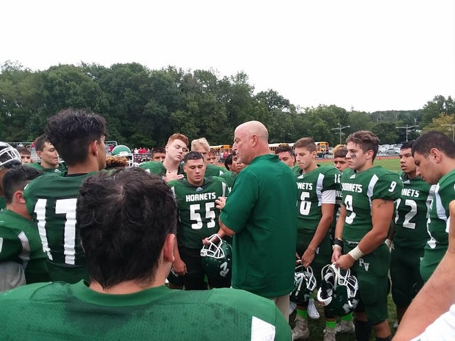 Passaic Valley coach Chet Parlavecchio addressing his football team after a tough loss to Lakeland.