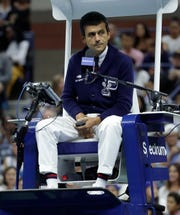 Chair umpire Carlos Ramos watches play as he officiates the match between Serena Williams and Naomi Osaka, of Japan, during the women's final of the U.S. Open tennis tournament, Saturday, Sept. 8, 2018, in New York.