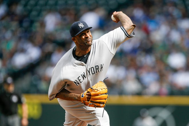 Sep 9, 2018; Seattle, WA, USA; New York Yankees starting pitcher CC Sabathia (52) throws against the Seattle Mariners during the first inning at Safeco Field.