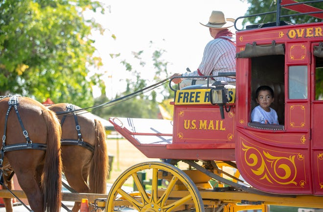 Jayden Chavez, 5, of Las Cruces, prepares to take a ride in a stage coach driven by Frontier Adventures Pete Paulson, on Saturday, September 8, 2018 during Monuments to Main Street at Klein Park.