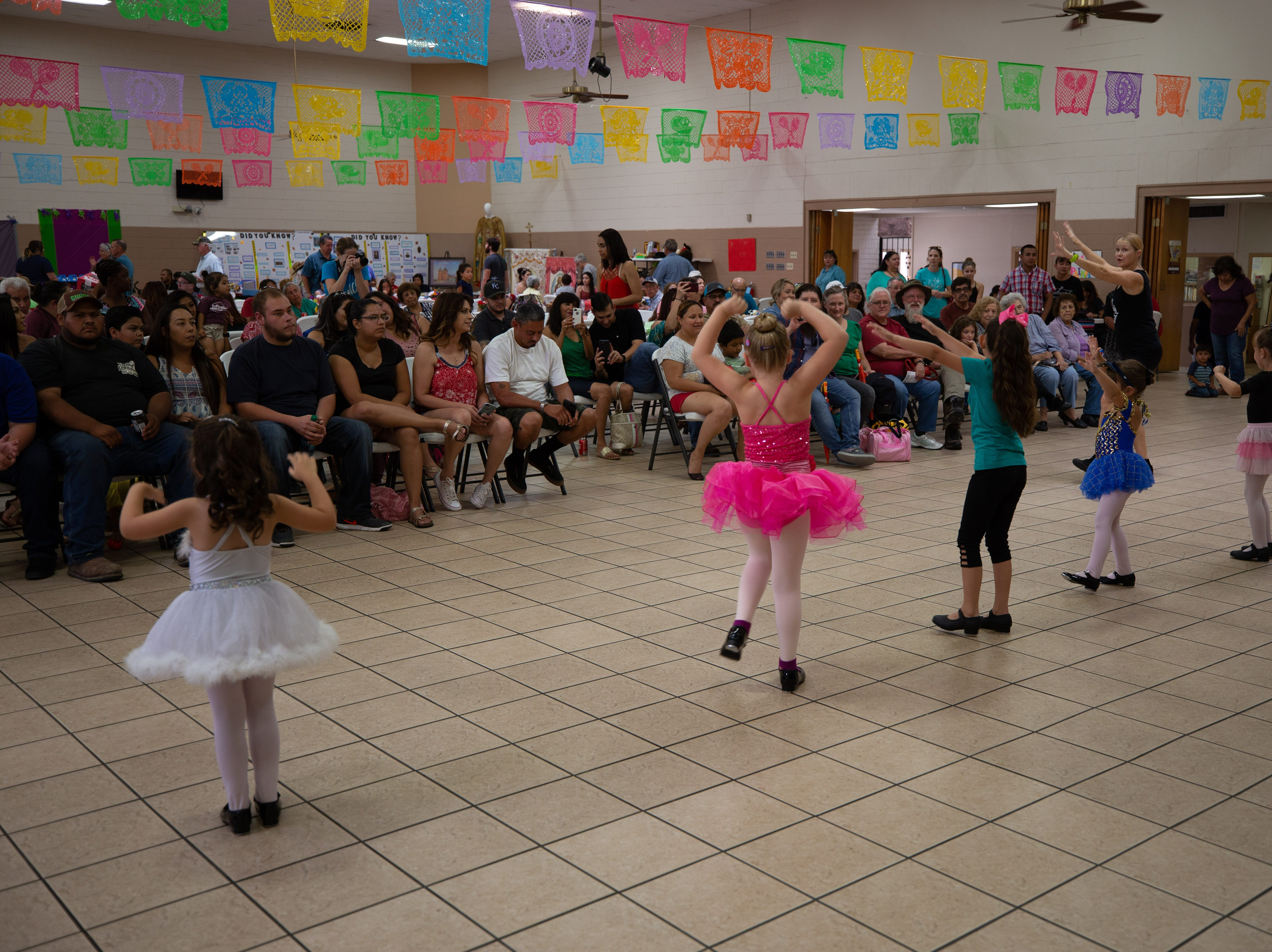 Michelle's Dance Academy instructor Charlie Ann Manning models for the young 3- to 6-year-old dancers as they entertain fiesta-goers at the St. Genevieve Fiesta on Saturday, Sept. 8, 2018.