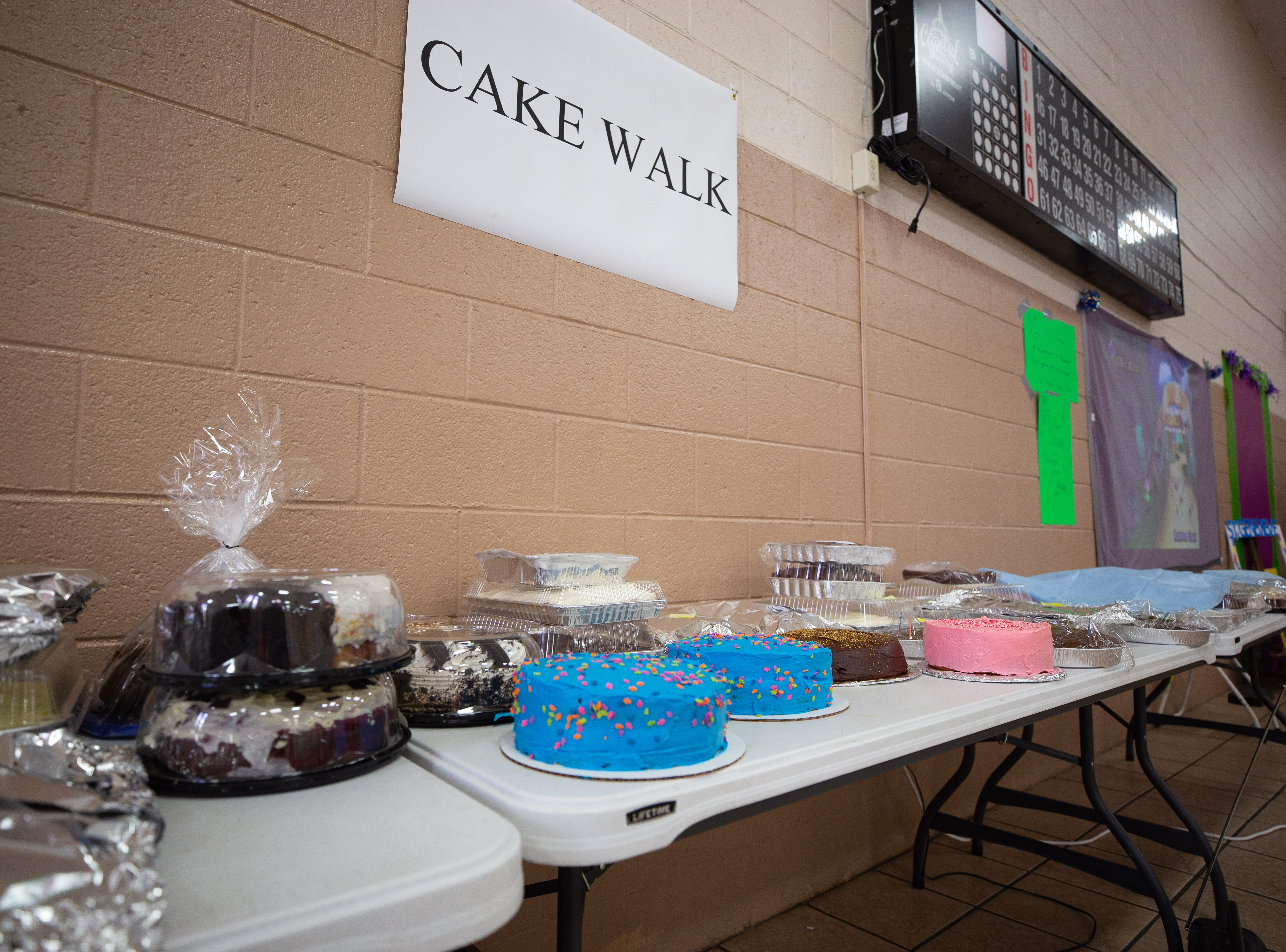 Colorful cakes await thier turn at the cakewalk booth at the St. Genevieve Fiesta on Saturday, Sept. 8, 2018.