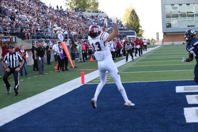 New Mexico State receiver Johnathan Boone hauls in a touchdown pass on Saturday against Utah State in Logan, Utah.