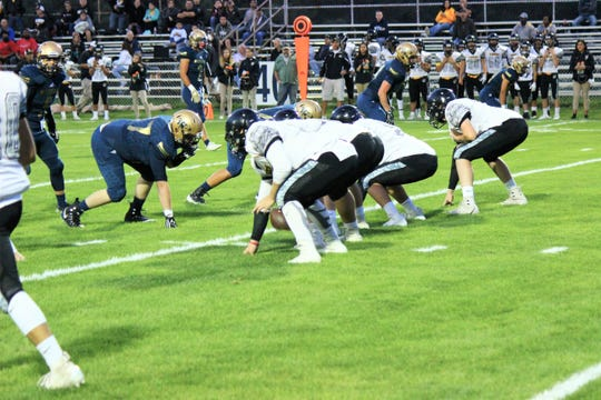 Alamogordo Tigers have possession of the ball fighting hard against the Ruidoso Warriors.