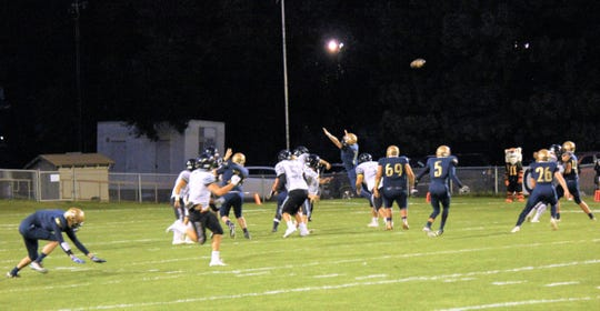 High flying Ruidoso receiver attempts to catch the pass.
