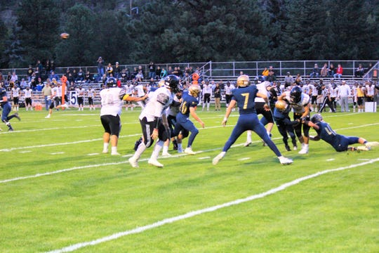 Warriors fight hard to move the ball down the field as they gain 1st down in the first half of a tight game.