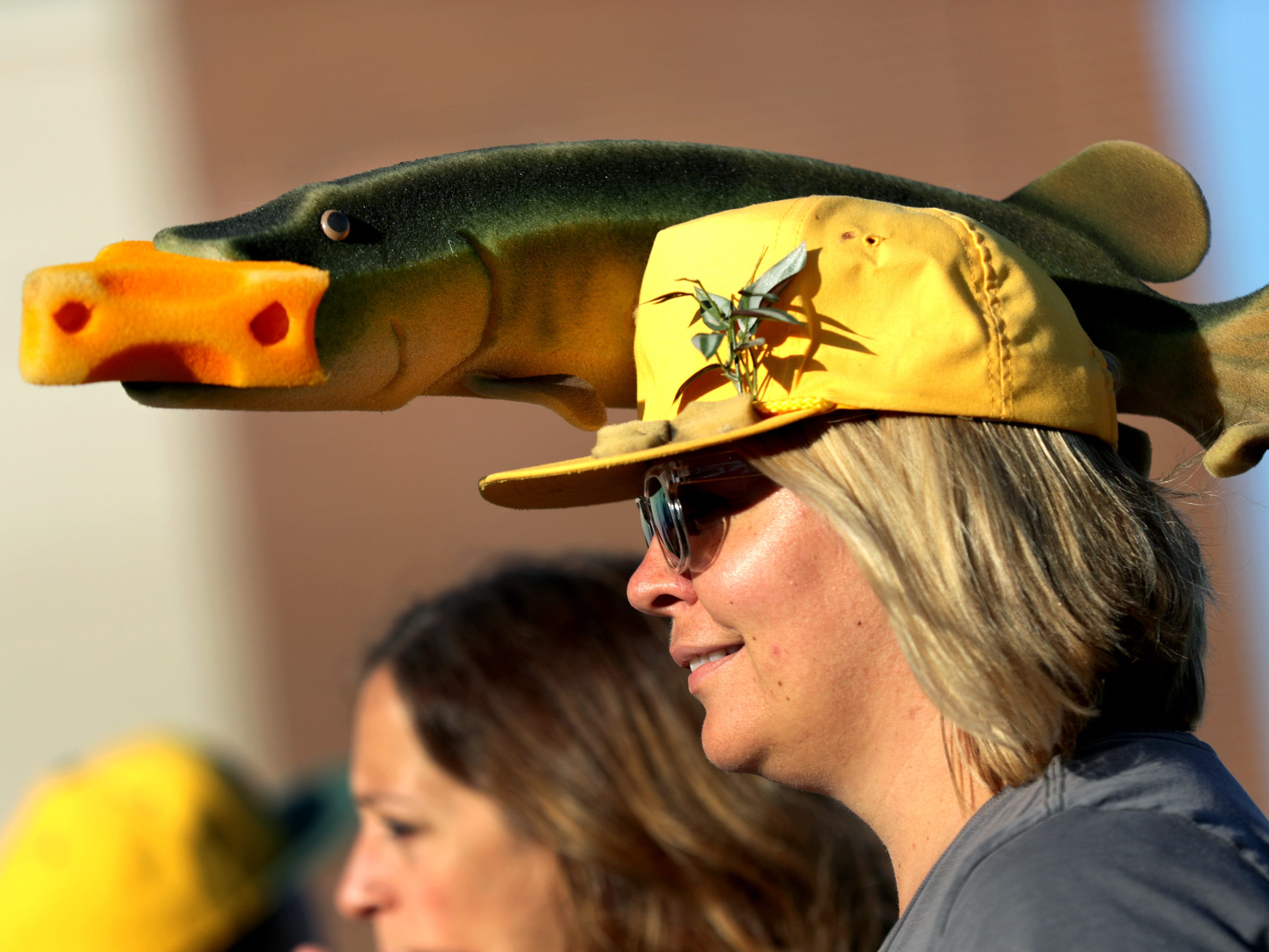 A Packers fan sports a muskie cheesehead before the Green Bay Packers host the Chicago Bears in the season opener on Sunday, September 9, 2018, at Lambeau Field in Green Bay, Wis.