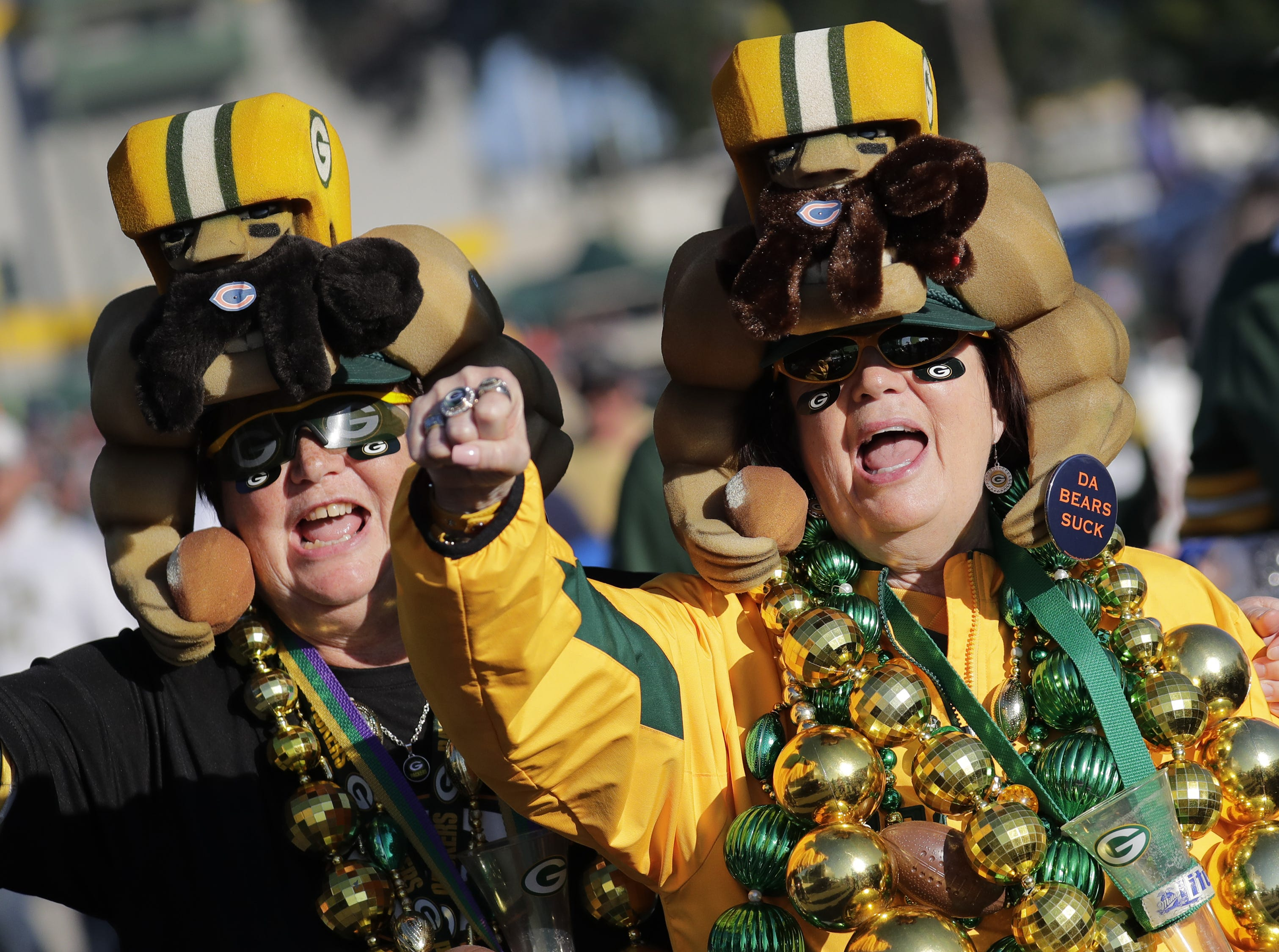 """Chris Schuelke, left, and her sister Jane Thiel, both of Dale, cheer """"Go Pack Go!"""", prior to the Green Bay Packers playing against the Chicago Bears Sunday, Sept. 9, 2018, at Lambeau Field in Green Bay, Wis."""
