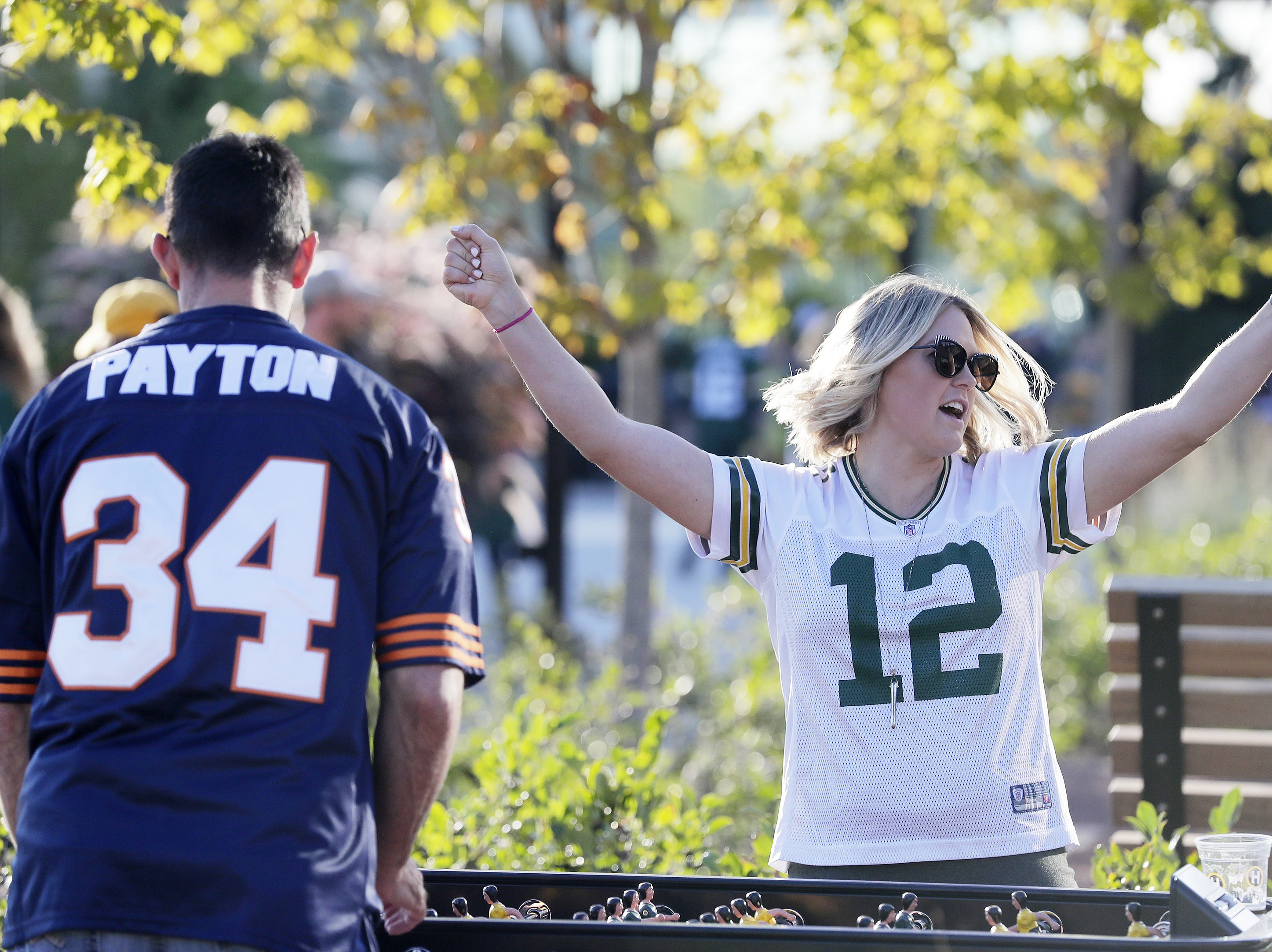 Brandon and Lindsay Kleve of Iowa play foosball before the Packers vs Bears game at Lambeau Field on Sunday, September 9, 2018 in Green Bay, Wis.