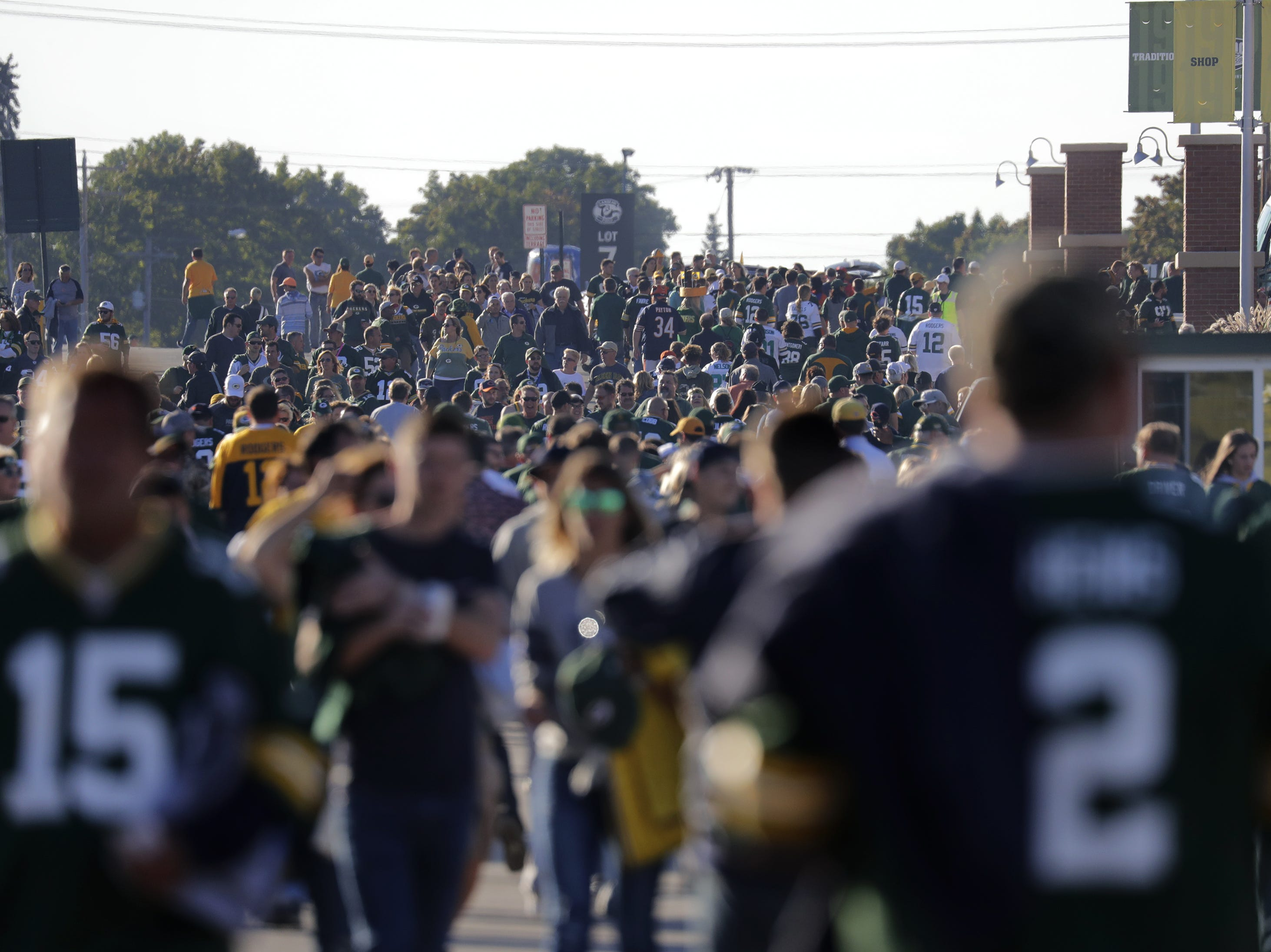 Fans walk the area around Lambeau Field before the Green Bay Packers play against the Chicago Bears Sunday, Sept. 9, 2018, at Lambeau Field in Green Bay, Wis.