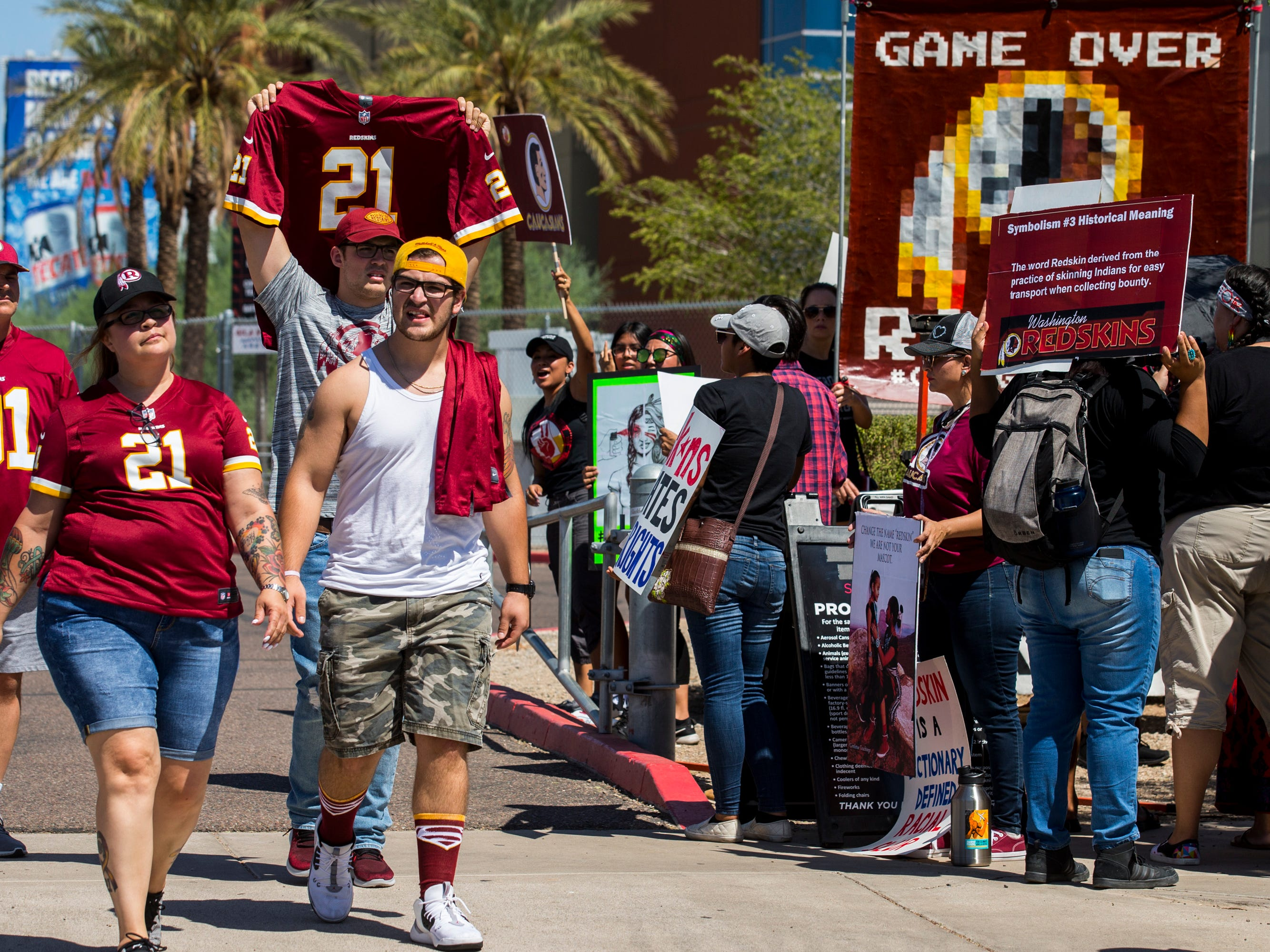People protest against Washington's mascot before the Cardinals game against the Redskins Sept. 9, 2018, at State Farm Stadium in Glendale.