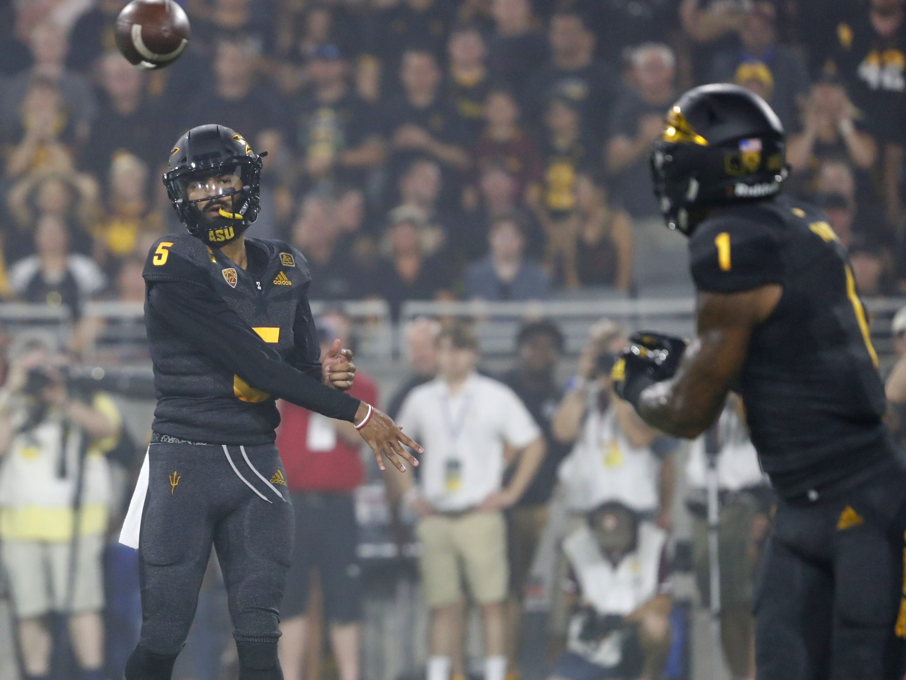 Arizona State Sun Devils quarterback Manny Wilkins (5) throws a pass to Arizona State Sun Devils wide receiver N'Keal Harry (1) during the first quarter against Michigan State at Sun Devil Stadium in Tempe, Ariz. on Sept. 8, 2018.