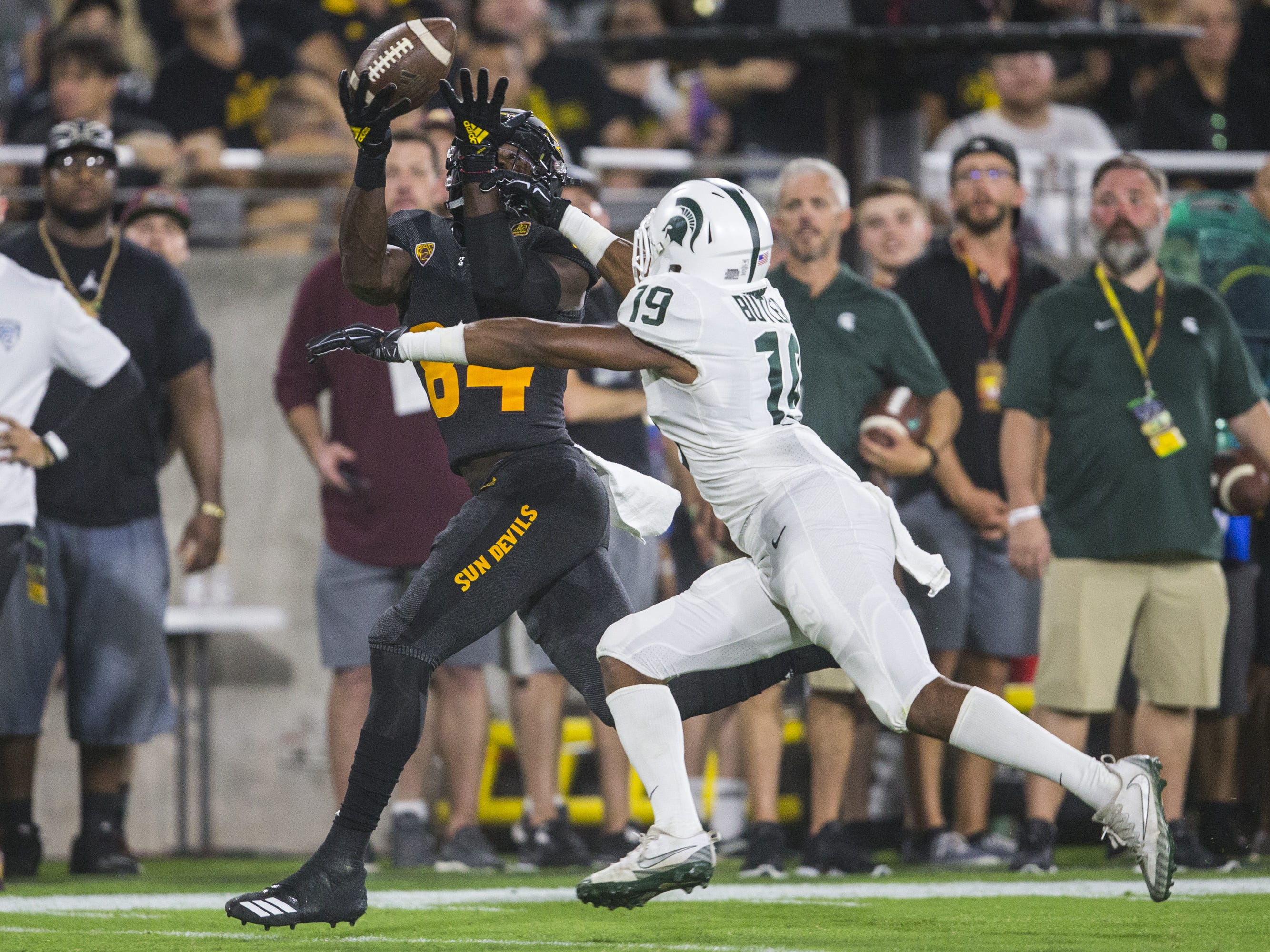 Arizona State's Frank Darby tries to make a catch but is broken up by Michigan State's Josh Butler in the 3rd quarter on Saturday, Sept. 8, 2018, at Sun Devil Stadium in Tempe, Ariz.