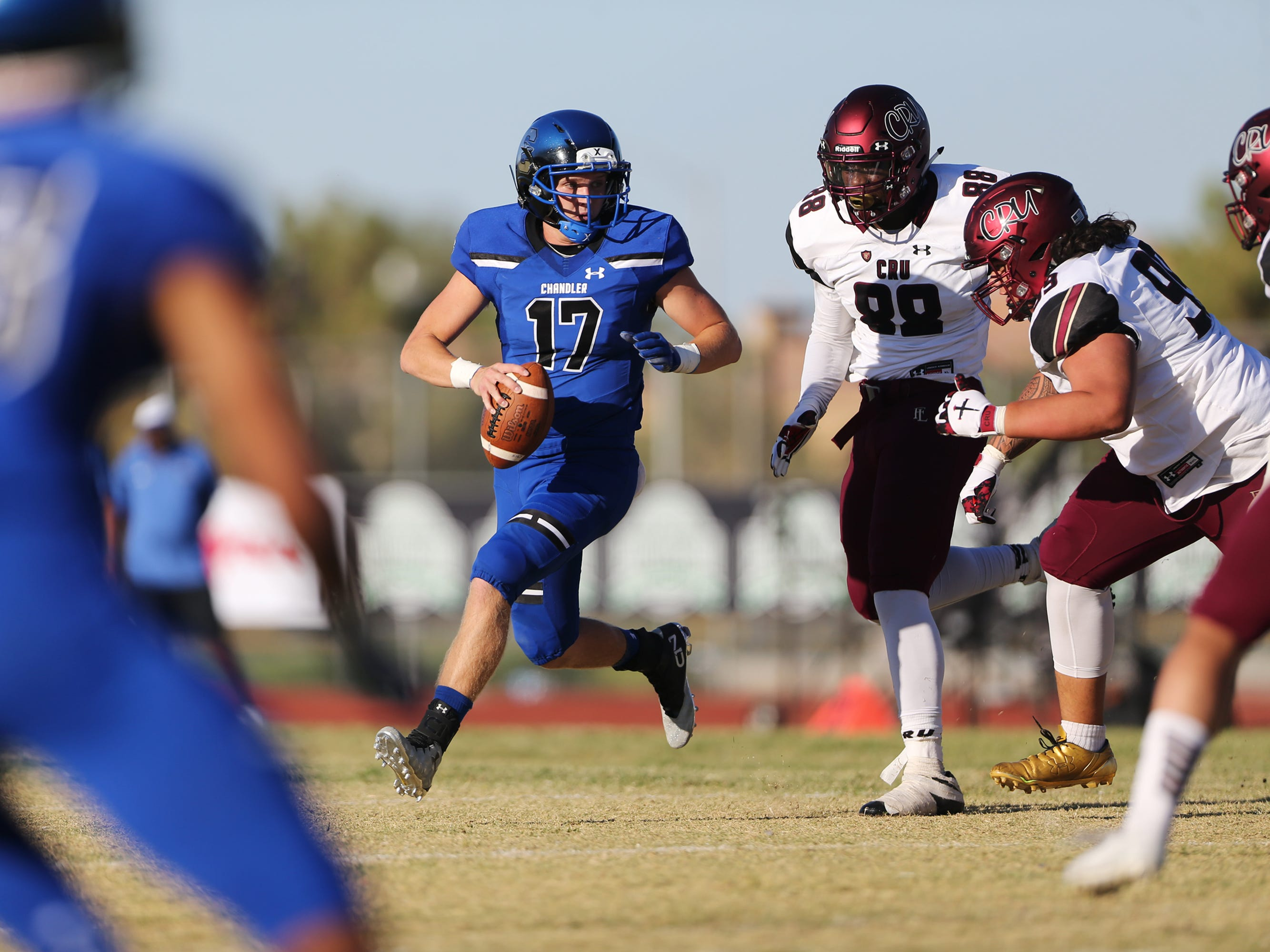 Chandler's Jacob Conover (17) looks for an open pass under pressure from Faith Lutheran's David Heckard (88) in a football game at Liberty High School in Henderson, Saturday, Sept. 8, 2018. Erik Verduzco Las Vegas Review-Journal @Erik_Verduzco