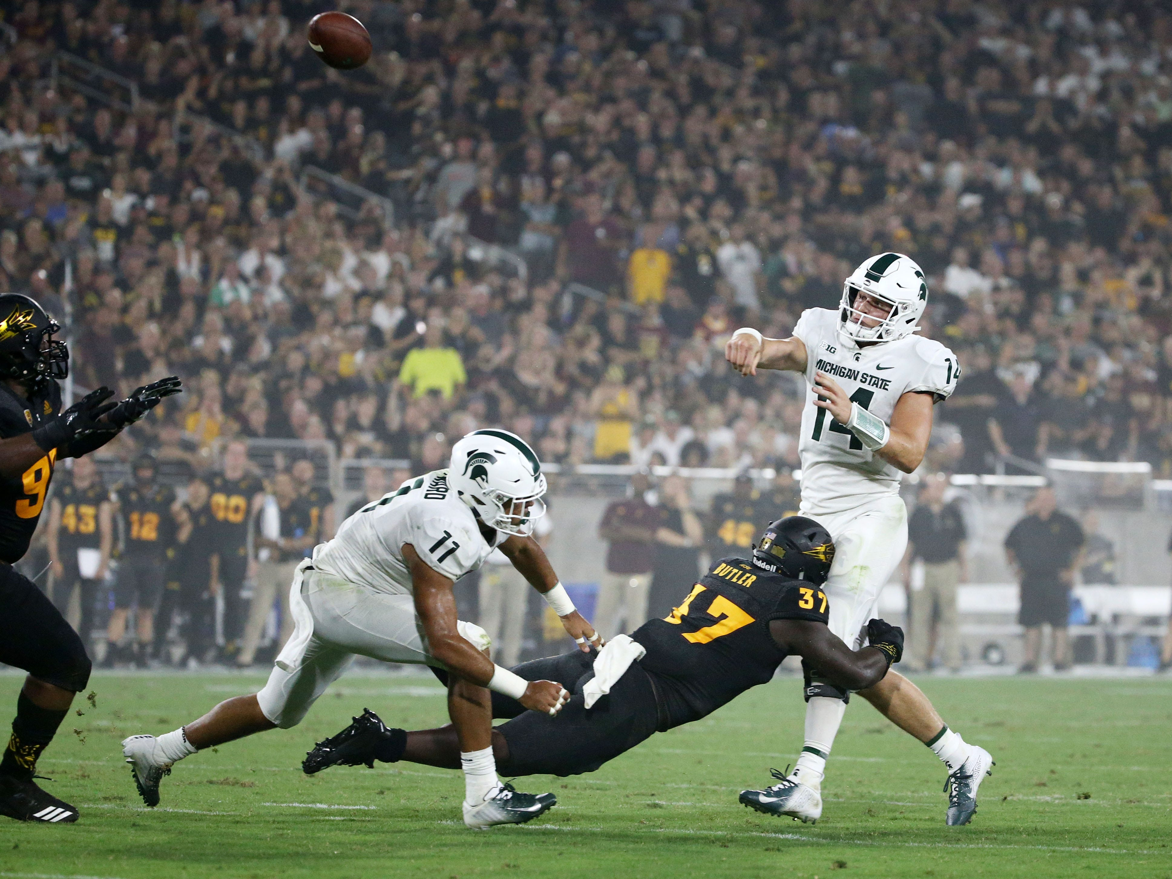Arizona State linebacker Darien Butler pressures the pass by Michigan State quarterback Brian Lewerke in the first half on Sep. 8, 2018, at Sun Devil Stadium.
