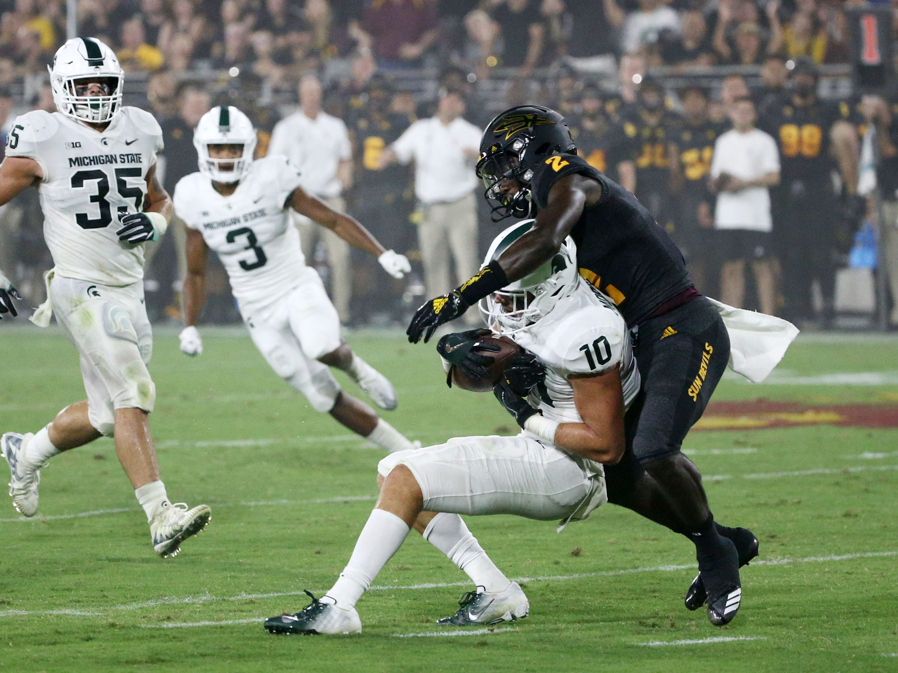 Michigan State safety Matt Morrissey intercepts a pass away from Arizona State wide receiver Brandon Aiyuk in the first half on Sep. 8, 2018, at Sun Devil Stadium.