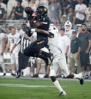 Arizona State wide receiver N'Keal Harry makes a catch over Michigan State cornerback Justin Layne on Sep. 8, 2018, at Sun Devil Stadium.