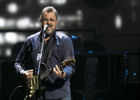 Vince Gill performs with the Eagles at Talking Stick Resort Arena in Phoenix on Sat. Sep. 8, 2018.