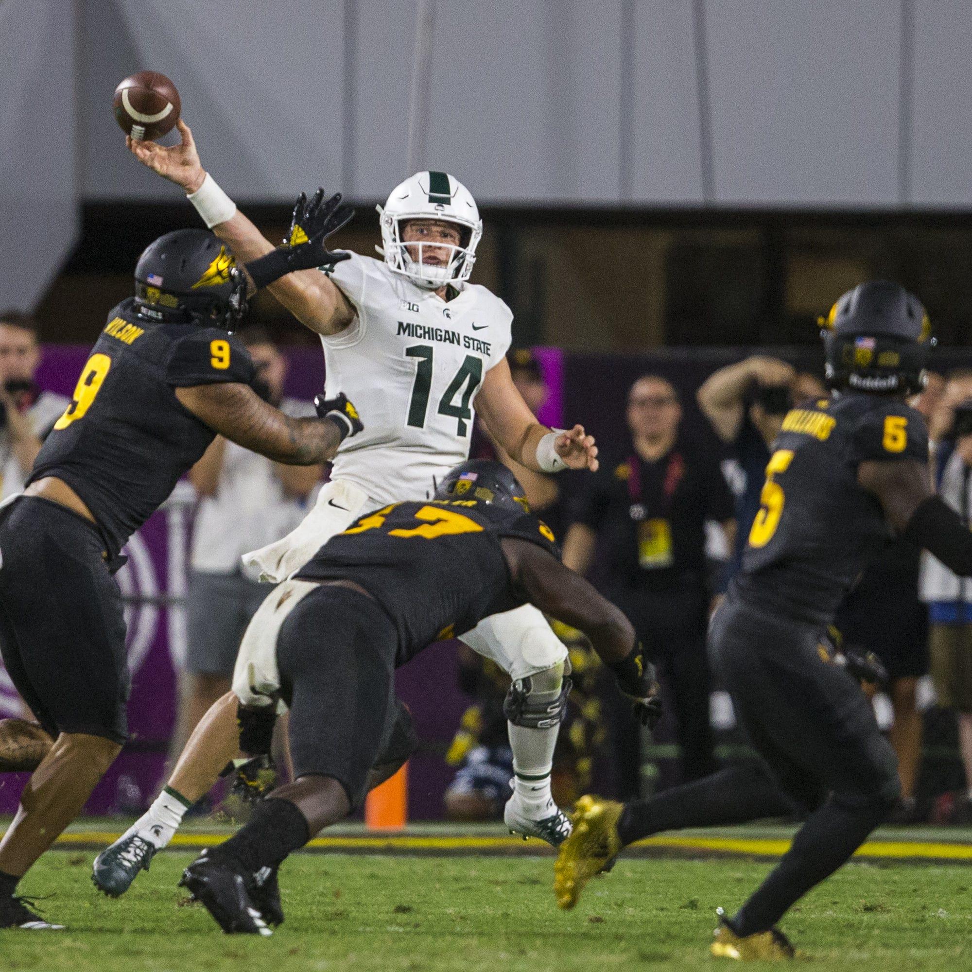 Michigan State's Brian Lewerke looks to pass against Arizona State in the 4th quarter on Saturday, Sept. 8, 2018, at Sun Devil Stadium in Tempe, Ariz. Arizona State won, 16-13.