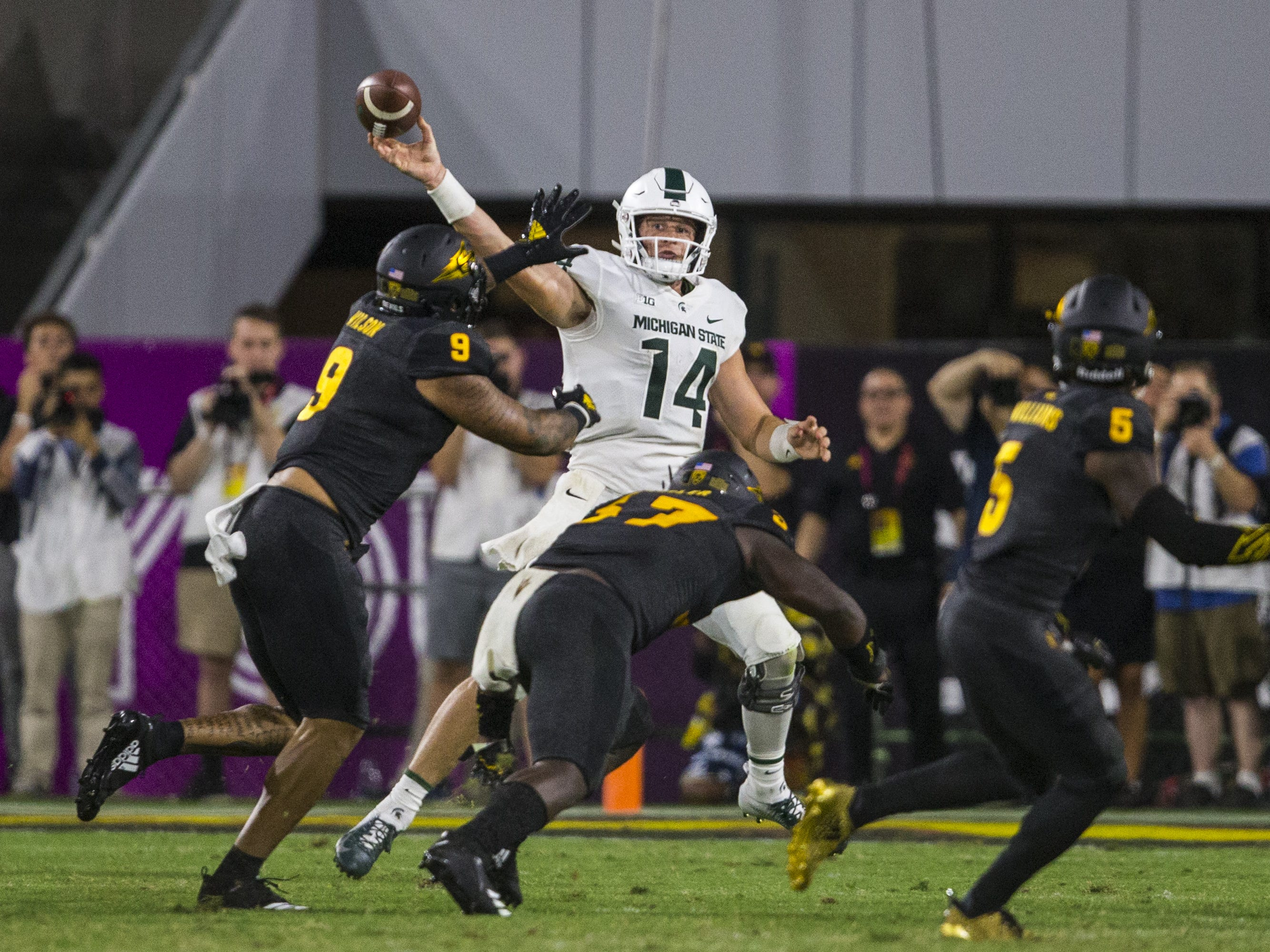 Michigan State's Brian Lewerke looks to pass against Arizona State in the 4th quarter on Saturday, Sept. 8, 2018, at Sun Devil Stadium in Tempe, Ariz. Arizona State won, 16-13.