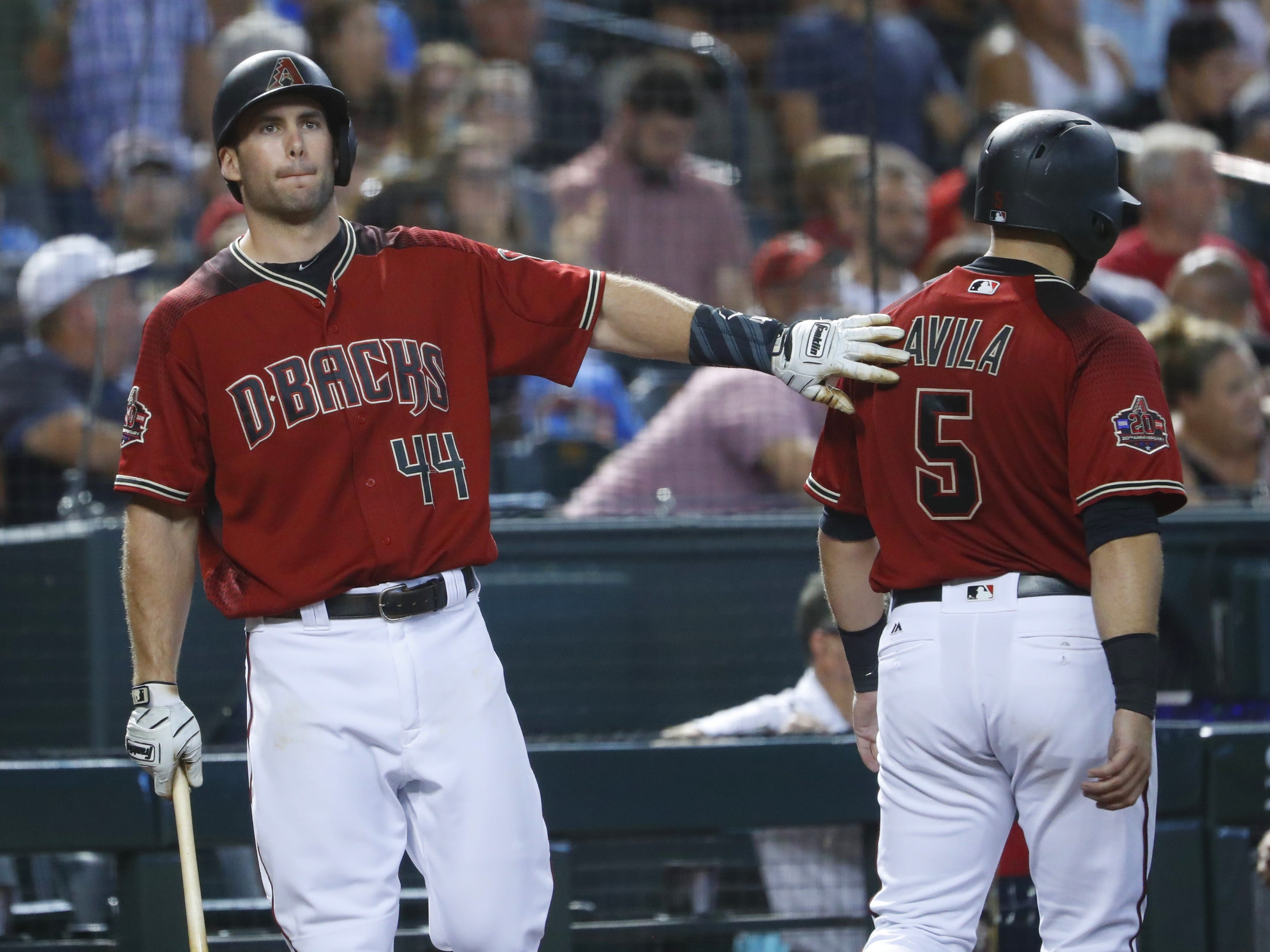 Diamondbacks Paul Goldschmidt (44) greets teammate Alex Avila (5) after Avila scored during the sixth inning against the Braves at Chase Field in Phoenix, Ariz. on Sept. 9, 2018.