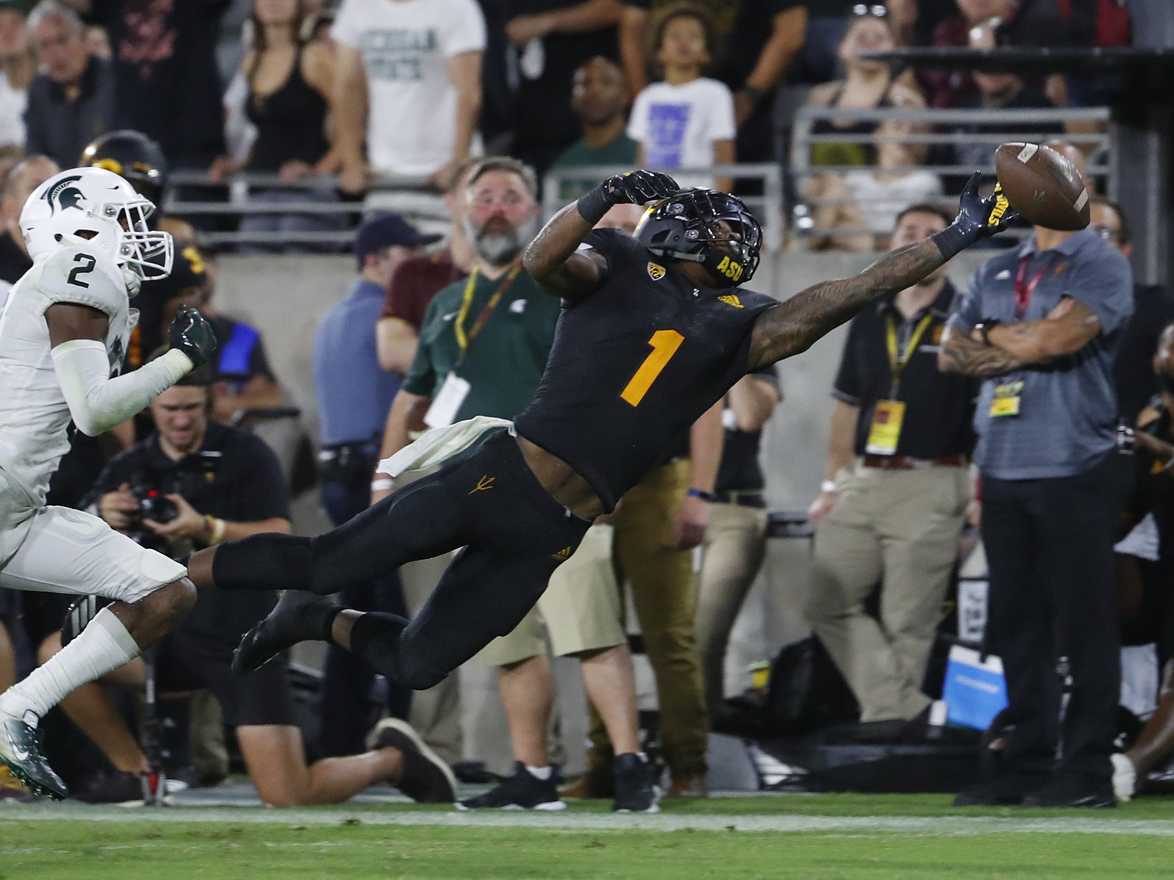 Arizona State Sun Devils wide receiver N'Keal Harry (1) dives but is unable to bring in a ball against Michigan State's Justin Layne (2) during the second quarter at Sun Devil Stadium in Tempe, Ariz. on Sept. 8, 2018.