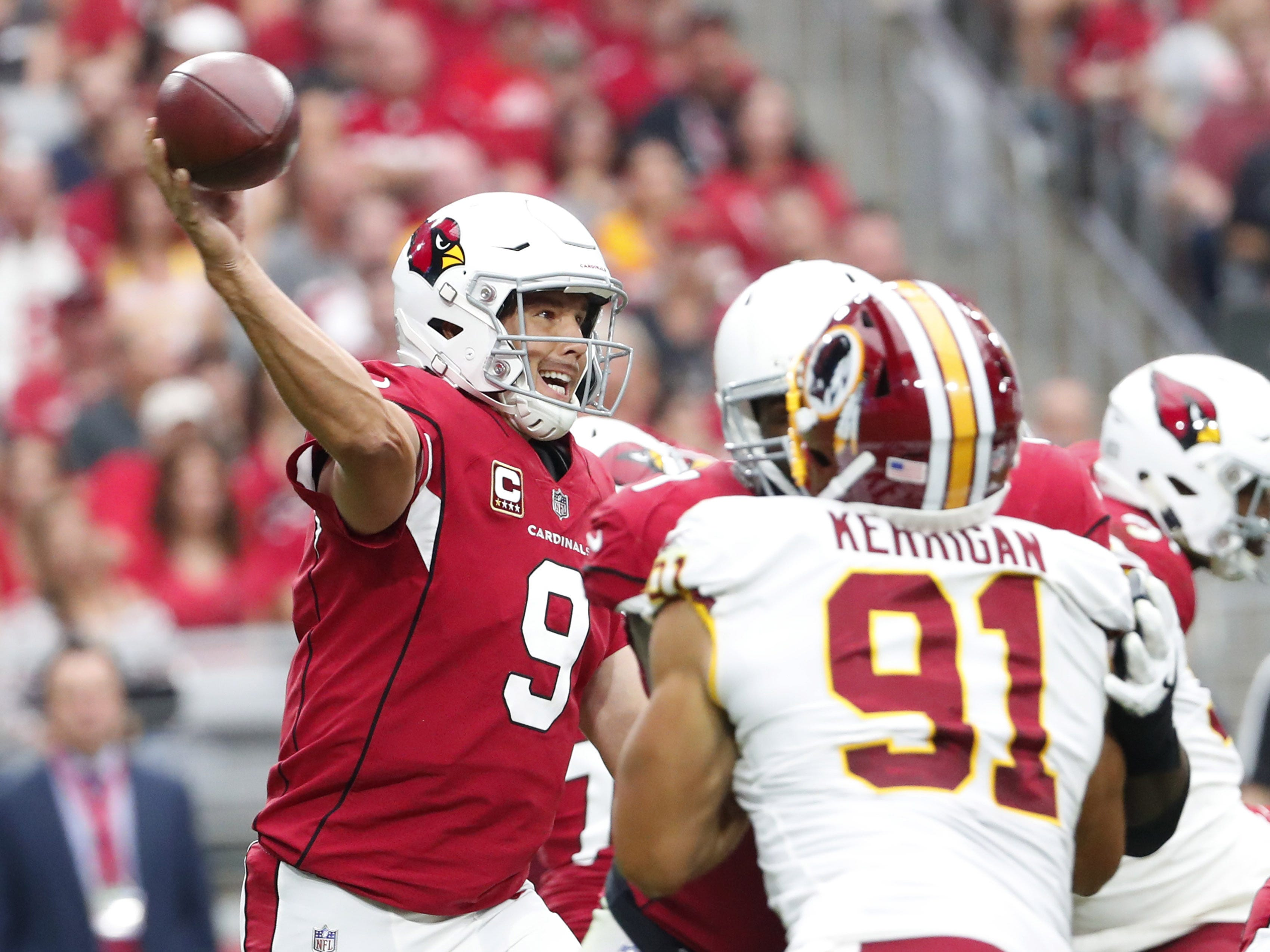 Arizona Cardinals quarterback Sam Bradford (9) throws a pass against the Washington Redskins during the second quarter at State Farm Stadium in Glendale, Ariz. September 9. 2018.