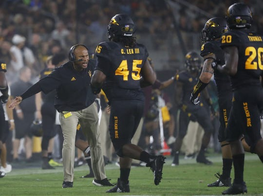 Arizona State's linebackers coach Antonio Pierce greets the defense after a stop against Michigan State during the second quarter at Sun Devil Stadium in Tempe, Ariz. on Sept. 8, 2018.