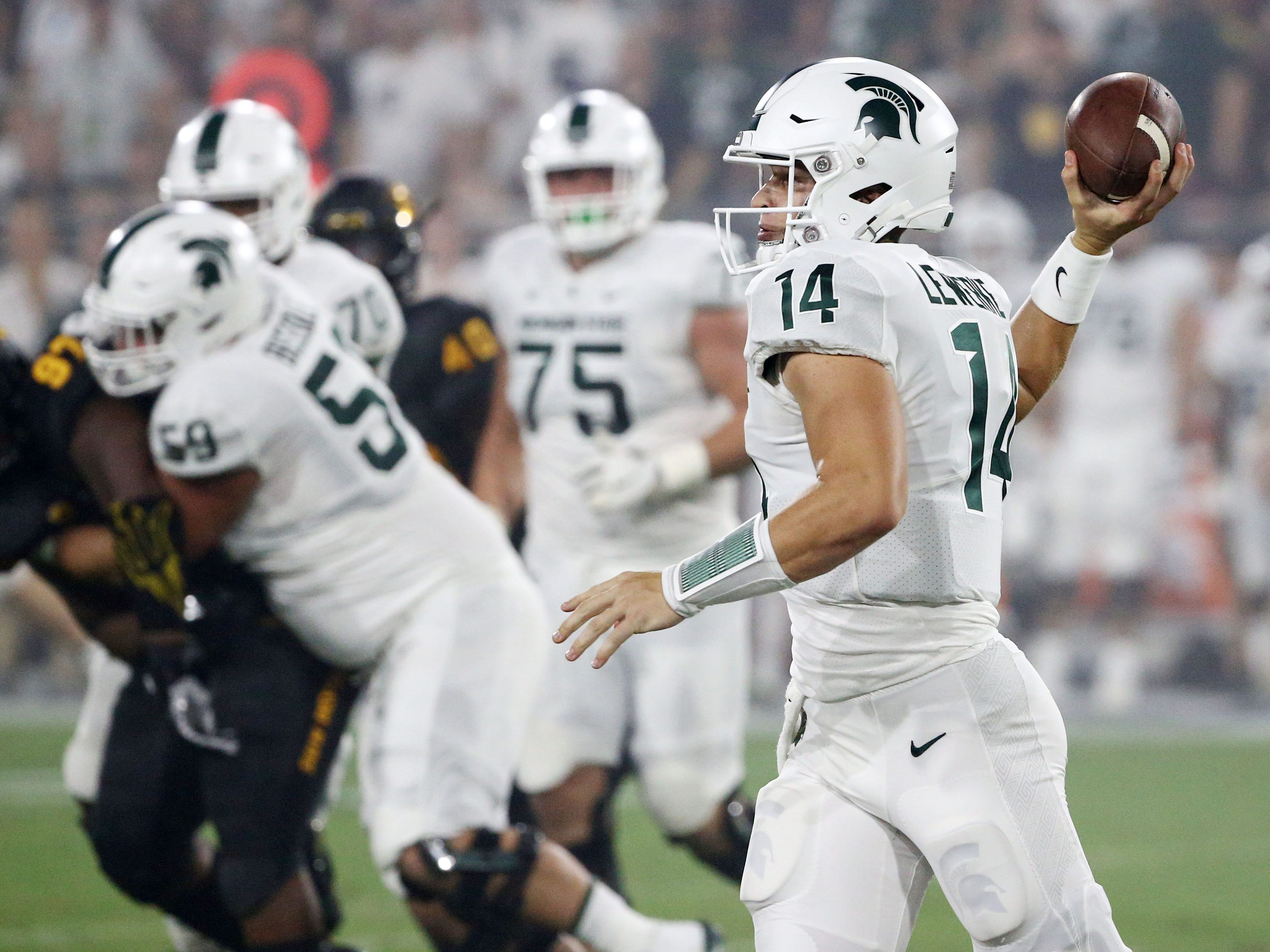 Michigan State quarterback Brian Lewerke throws a pass against Arizona State on Sep. 8, 2018, at Sun Devil Stadium.