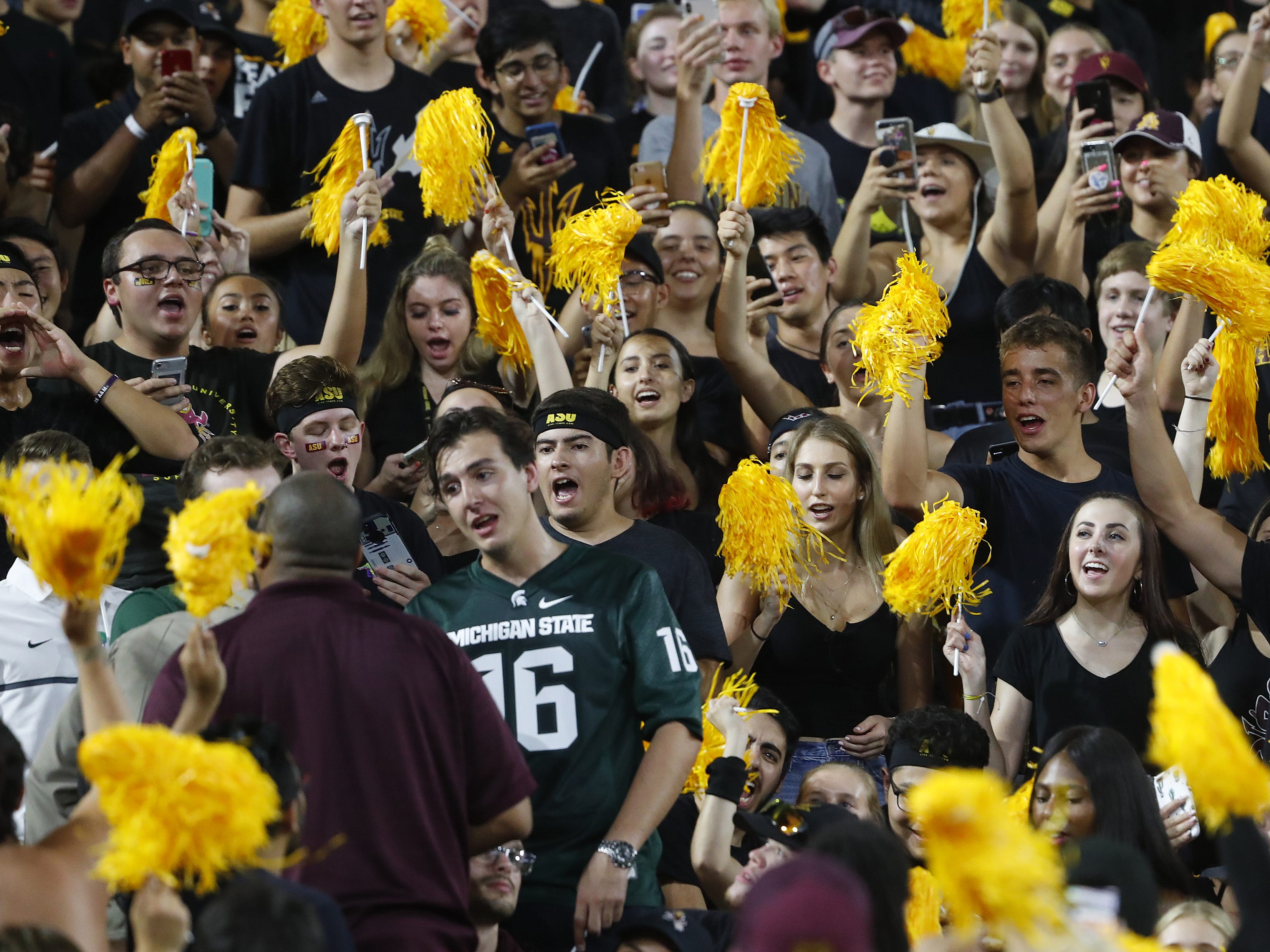 ASU fans chant to have Michigan State fans removed from student section during the second quarter at Sun Devil Stadium in Tempe, Ariz. on Sept. 8, 2018.