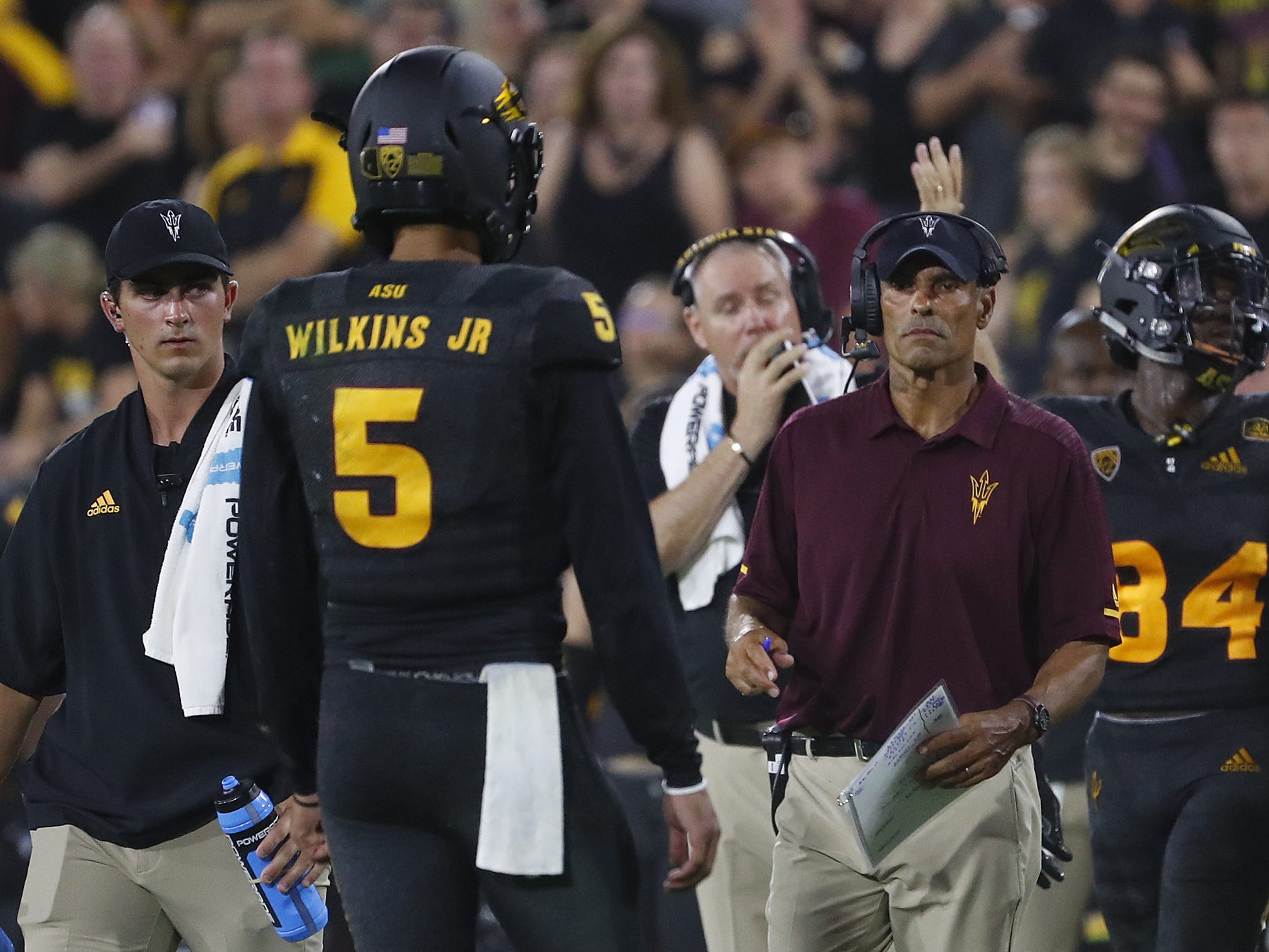 ASU's head coach Herm Edwards talks to Arizona State Sun Devils quarterback Manny Wilkins (5) during the fourth quarter against Michigan State at Sun Devil Stadium in Tempe, Ariz. on Sept. 8, 2018.