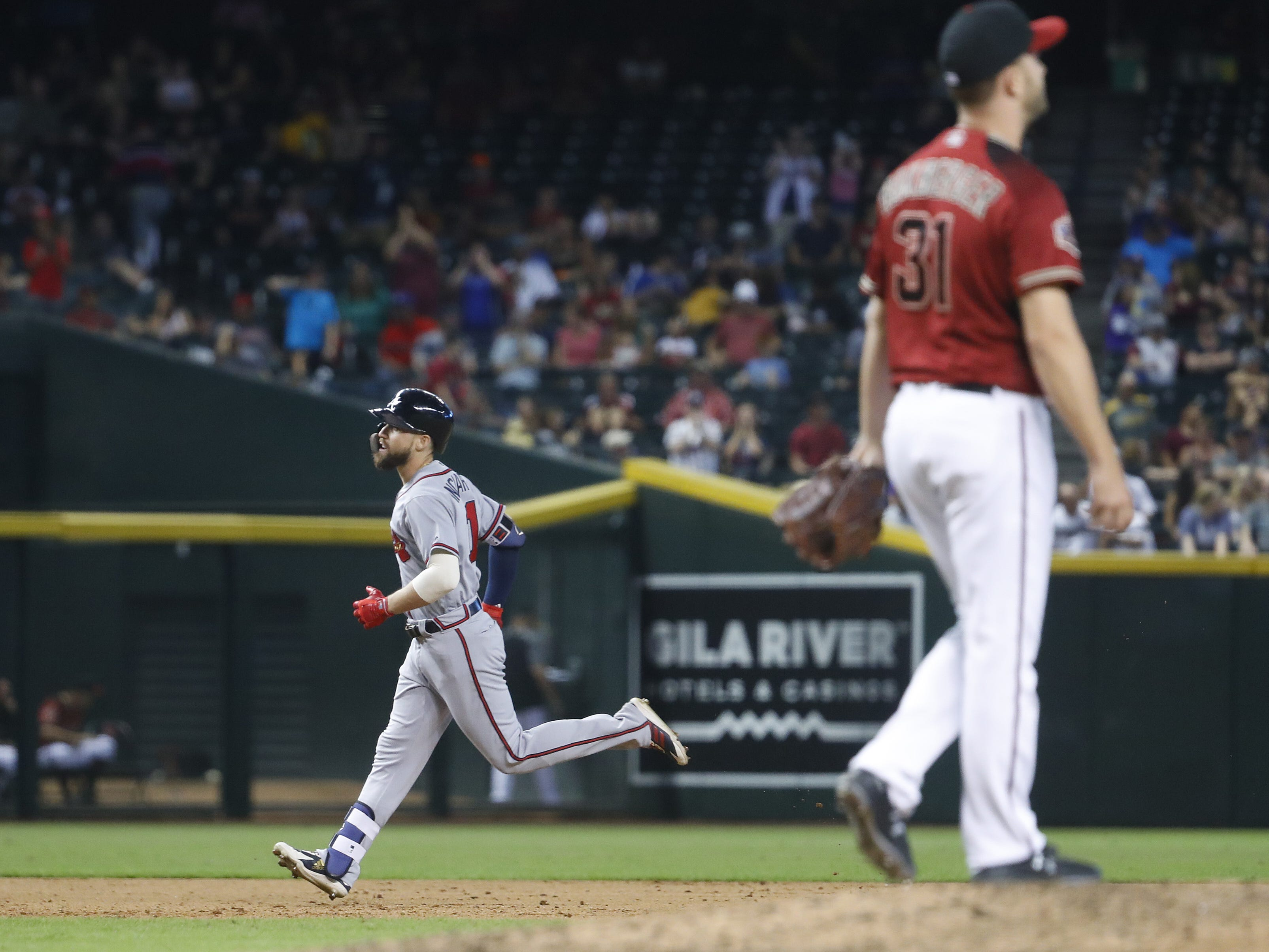 Diamondbacks closer Brad Boxberger reacts giving up a three-run home run to Braves Ender Inciarte (11) during the ninth inning at Chase Field in Phoenix, Ariz. on Sept. 9, 2018.