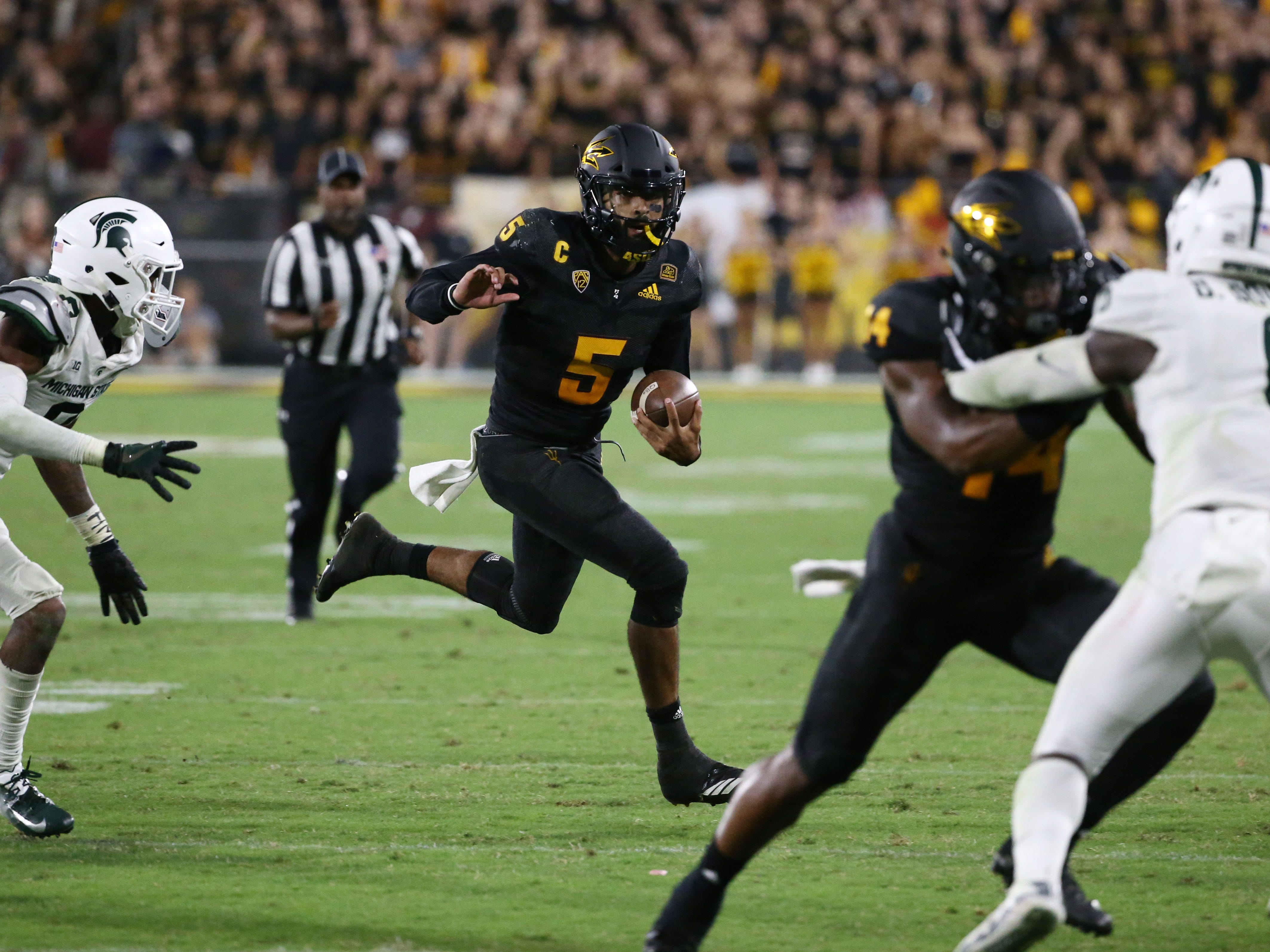 Arizona State quarterback Manny Wilkins runs out of the pocket against Michigan State in the second half on Sep. 8, 2018, at Sun Devil Stadium.