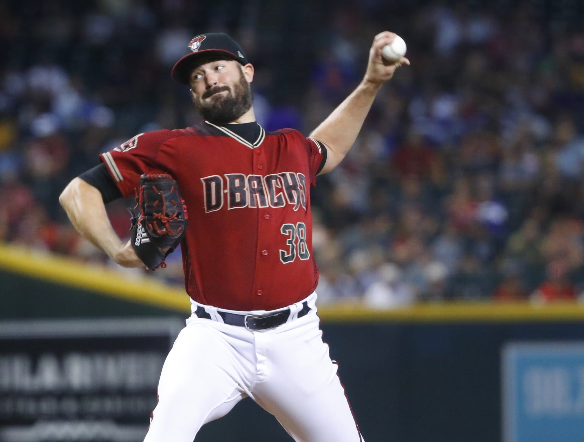 Diamondbacks Robbie Ray (38) pitches against the Braves during the first inning at Chase Field in Phoenix, Ariz. on Sept. 9, 2018.