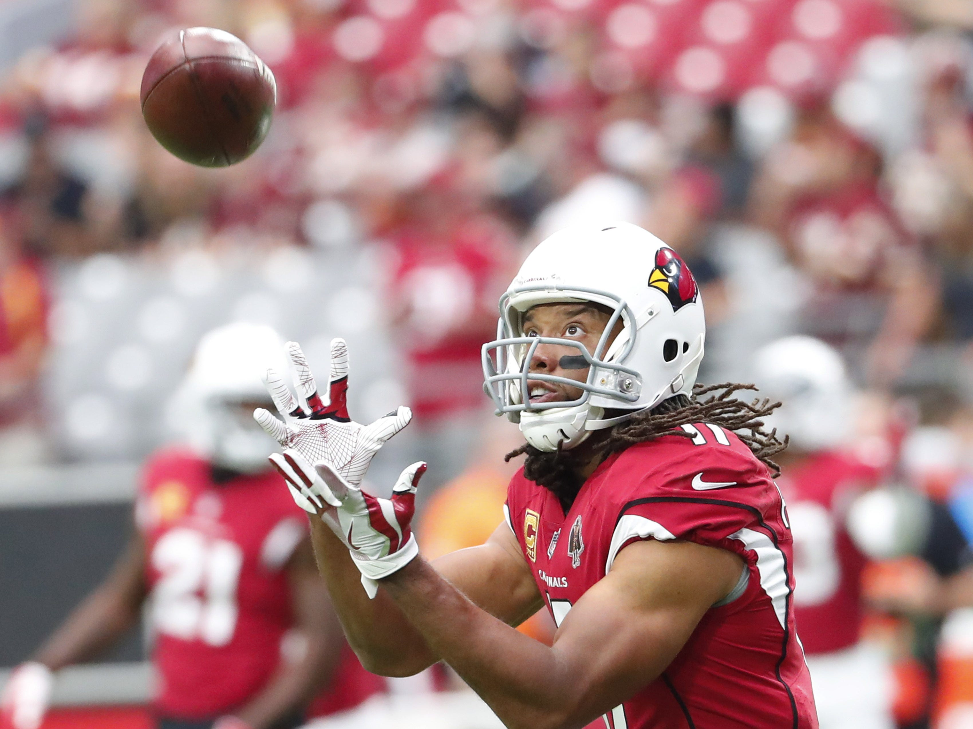 Arizona Cardinals wide receiver Larry Fitzgerald (11) warms up before playing against the Washington Redskins at State Farm Stadium in Glendale, Ariz. September 9. 2018.