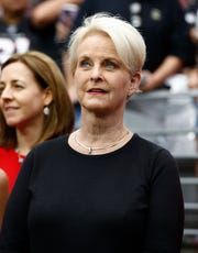 Cindy McCain, wife of the late U.S. Sen. John McCain, stands on the sidelines prior to an NFL football game between the Washington Redskins and the Arizona Cardinals, Sept. 9, 2018, in Glendale, Ariz.