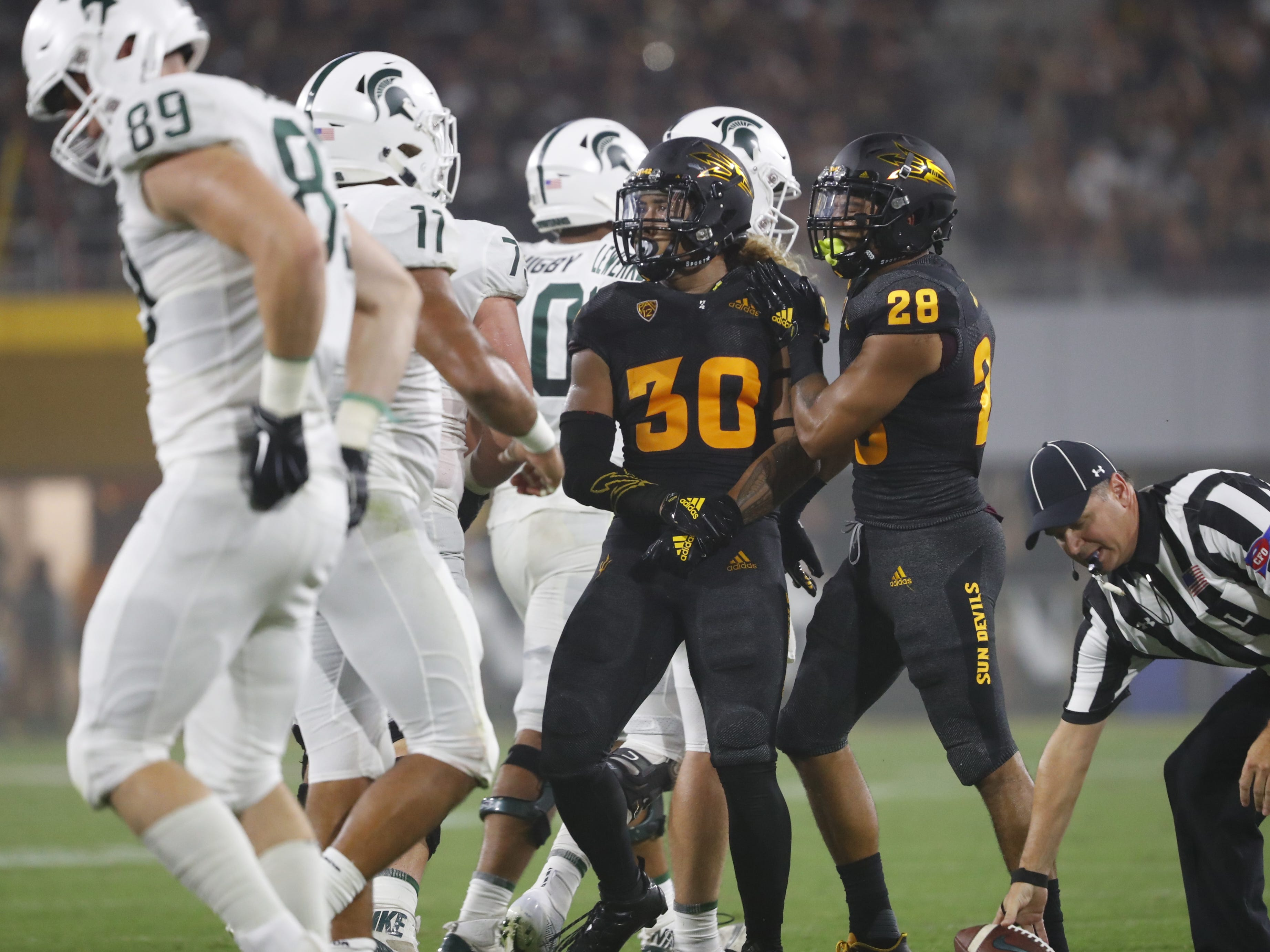 Arizona State Sun Devils defensive back Demonte King (28) celebrates with Arizona State Sun Devils defensive back Dasmond Tautalatasi (30) after Tautalatasi made an interception in the end zone during the second quarter at Sun Devil Stadium in Tempe, Ariz. on Sept. 8, 2018.