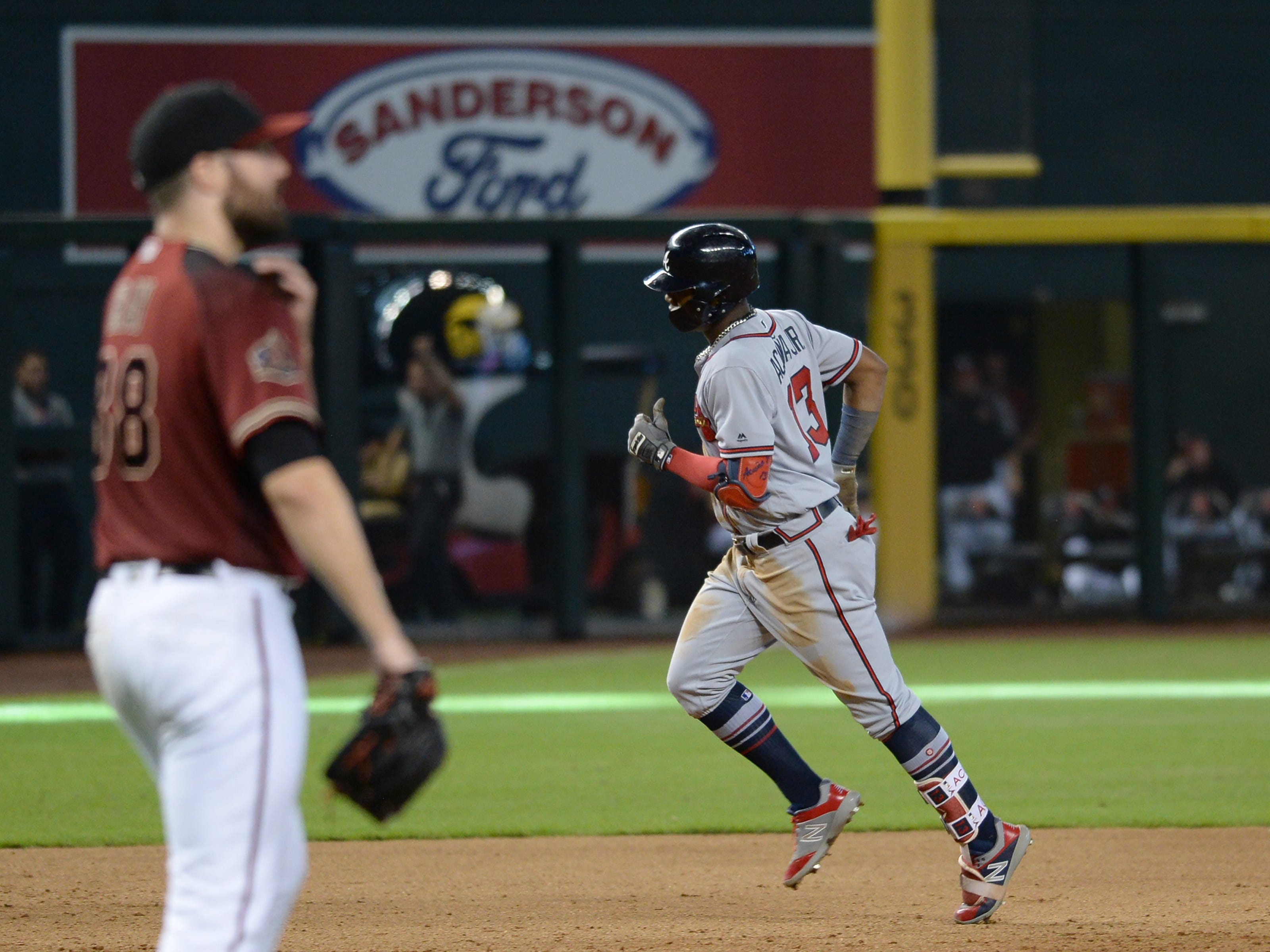Sep 9, 2018; Phoenix, AZ, USA; Atlanta Braves left fielder Ronald Acuna Jr. (13) runs the bases after hitting a two-run home run against the Arizona Diamondbacks during the sixth inning at Chase Field.