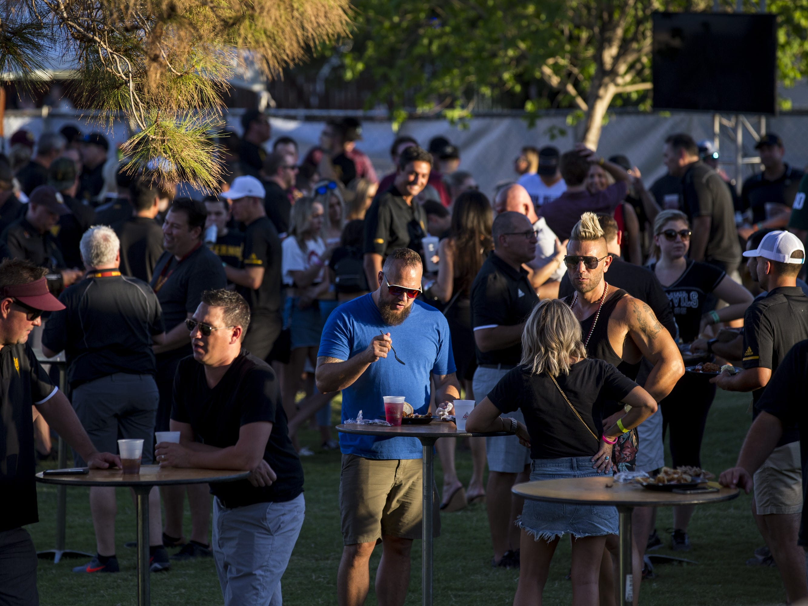 Fans tailgate before the game against Michigan State on Saturday, Sept. 8, 2018, at Sun Devil Stadium in Tempe, Ariz.