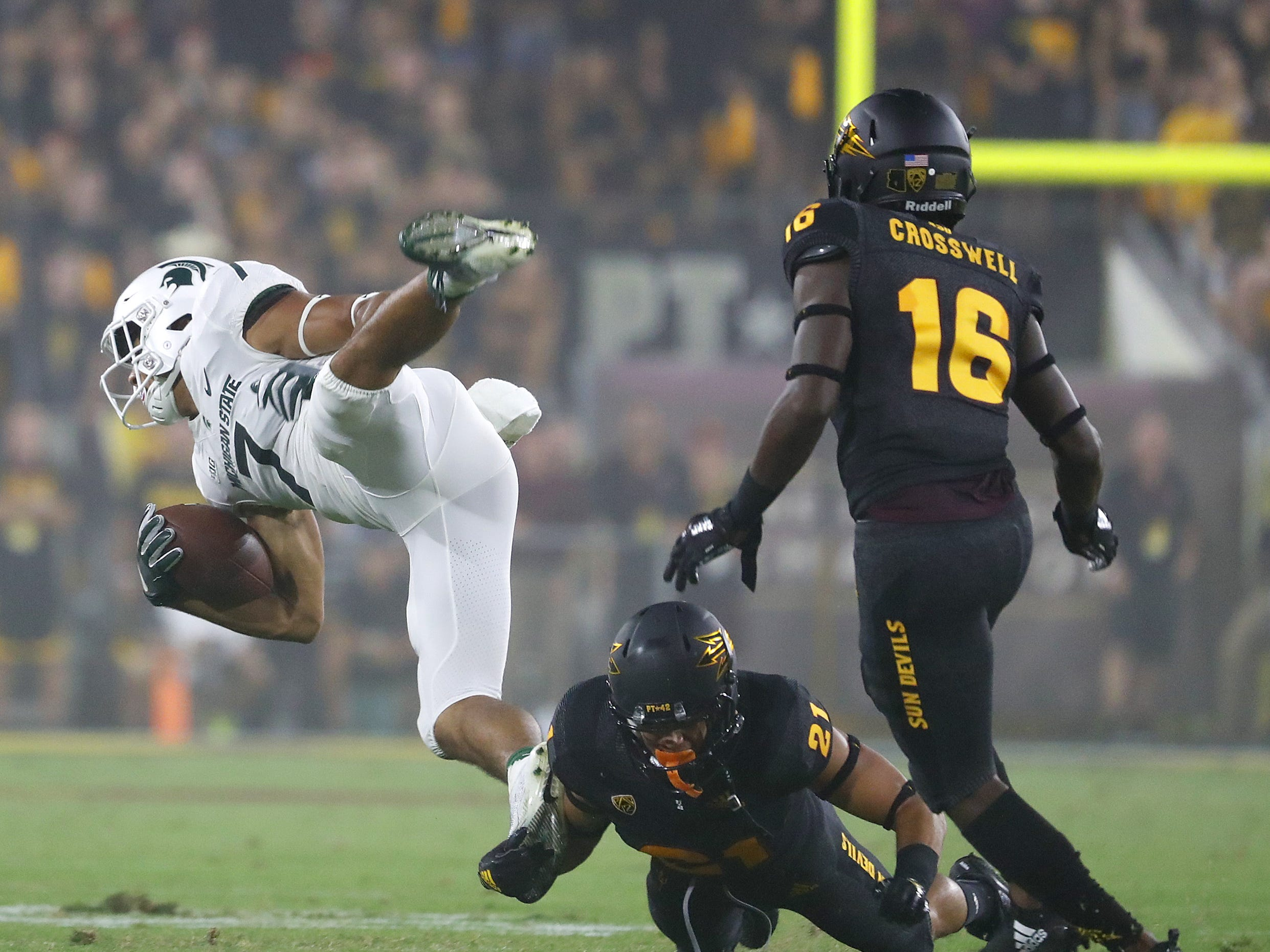 Arizona State Sun Devils cornerback Terin Adams (21) tackles Michigan State's Cody White (7) during the second quarter at Sun Devil Stadium in Tempe, Ariz. on Sept. 8, 2018.