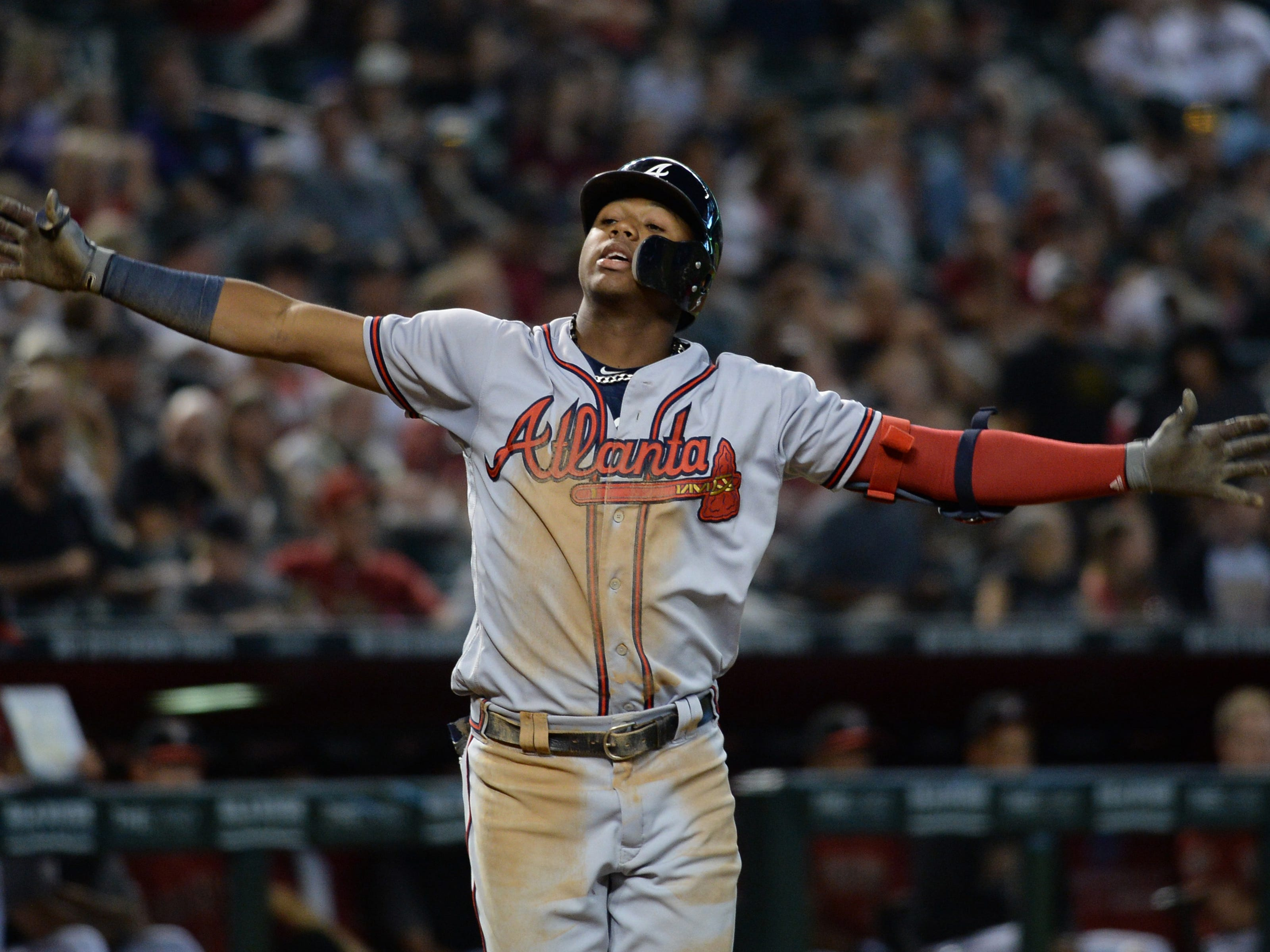 Sep 9, 2018; Phoenix, AZ, USA; Atlanta Braves left fielder Ronald Acuna Jr. (13) celebrates after hitting a two-run home run against the Arizona Diamondbacks during the sixth inning at Chase Field.