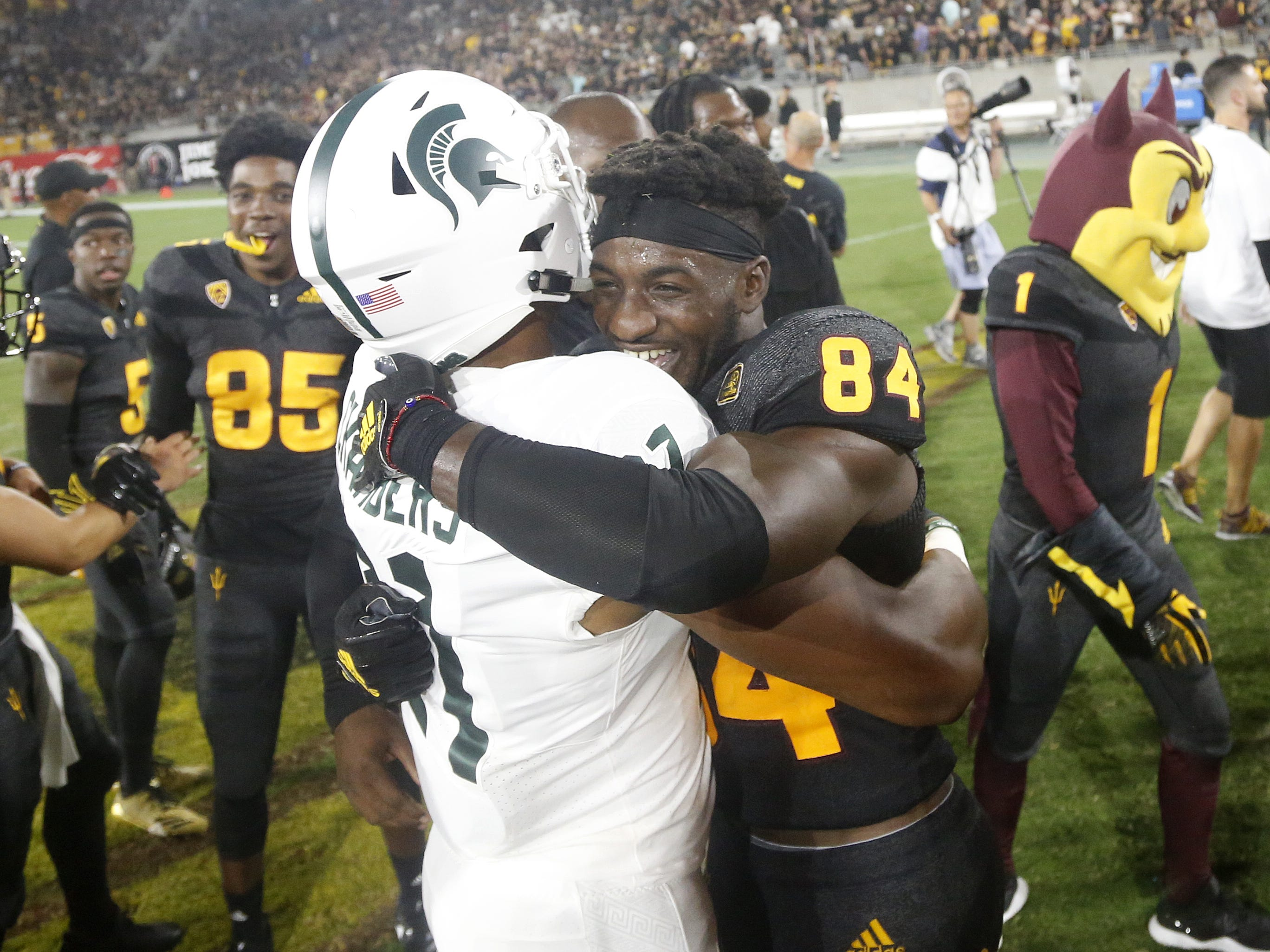 Arizona State Sun Devils wide receiver Frank Darby (84) high-fives Cam Chambers after ASU defeat Michigan State 16-13 at Sun Devil Stadium in Tempe, Ariz. on Sept. 8, 2018.