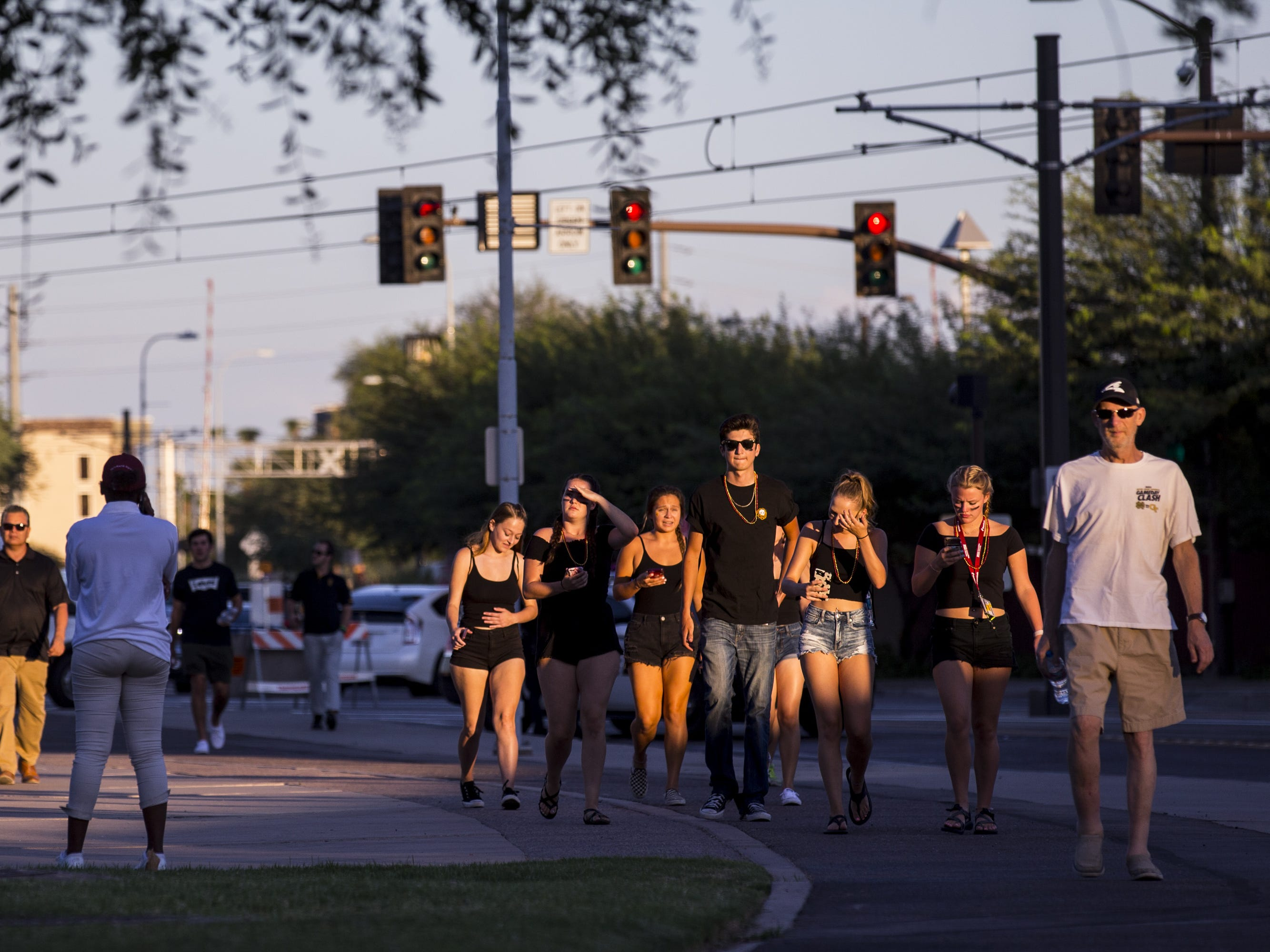 Fans walk to the stadium before the game against Michigan State on Saturday, Sept. 8, 2018, at Sun Devil Stadium in Tempe, Ariz.