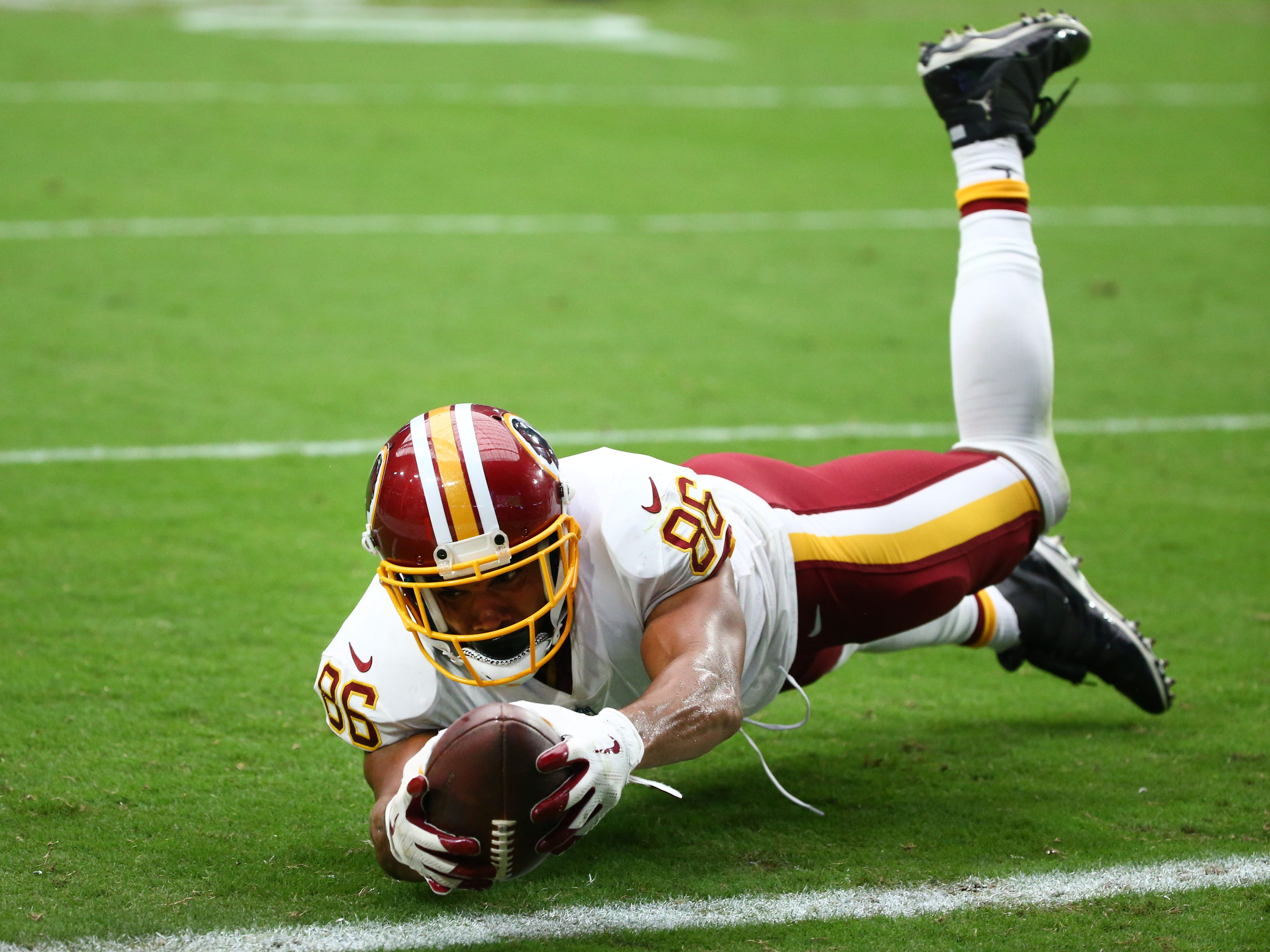 Washington Redskins tight end Jordan Reed dives for a touchdown against the Arizona Cardinals in the first half at State Farm Stadium.