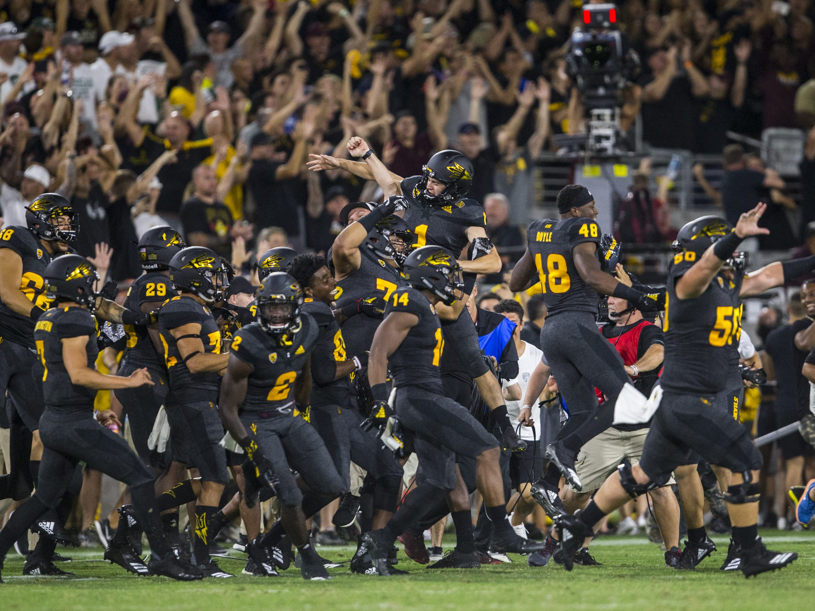 Arizona State celebrates after Brandon Ruiz kicked the game-winning field goal against Michigan State in the 4th quarter on Saturday, Sept. 8, 2018, at Sun Devil Stadium in Tempe, Ariz. Arizona State won, 16-13.