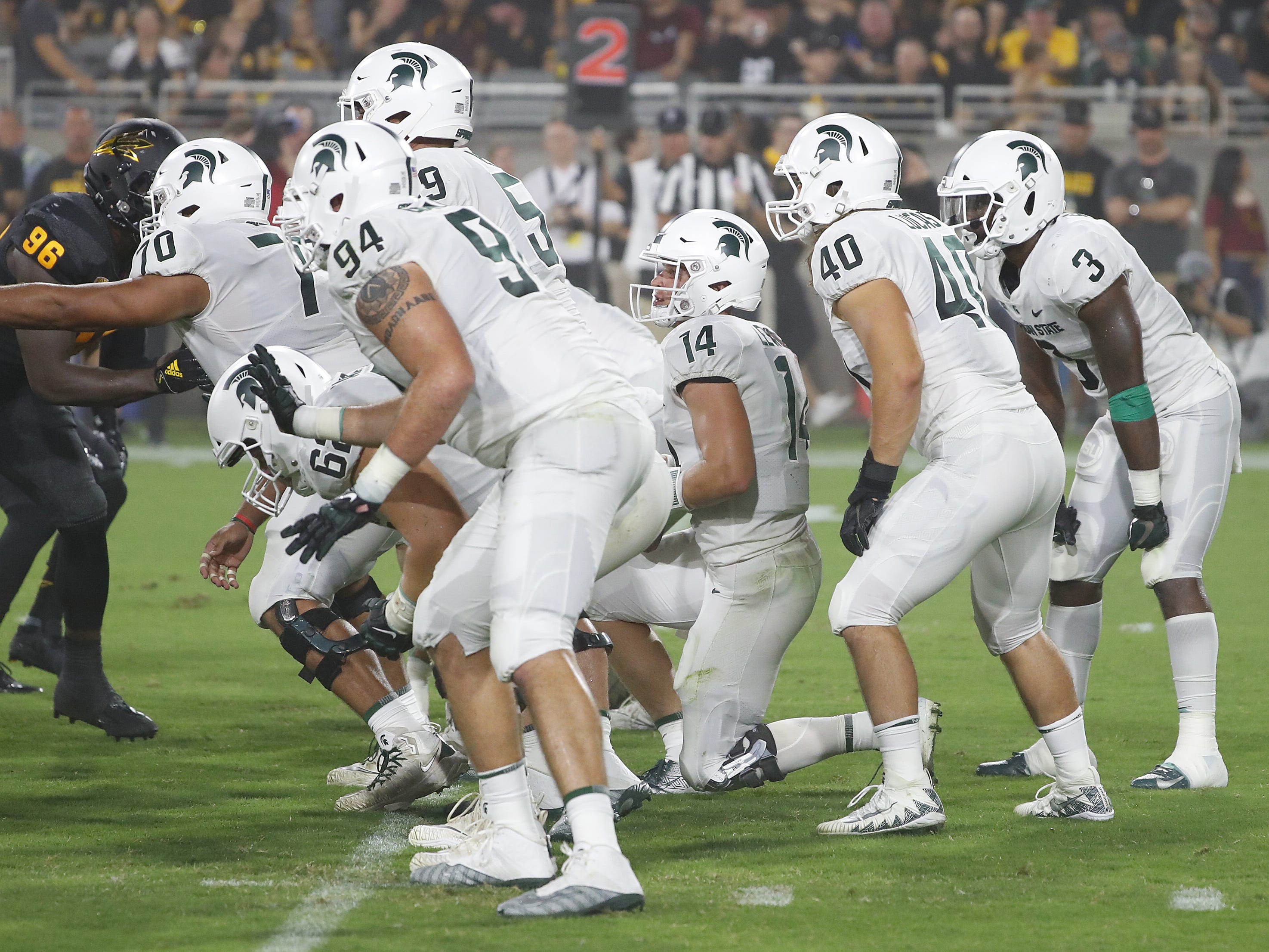 Michigan State kneels to end the first half against Arizona State at Sun Devil Stadium in Tempe, Ariz. on Sept. 8, 2018.
