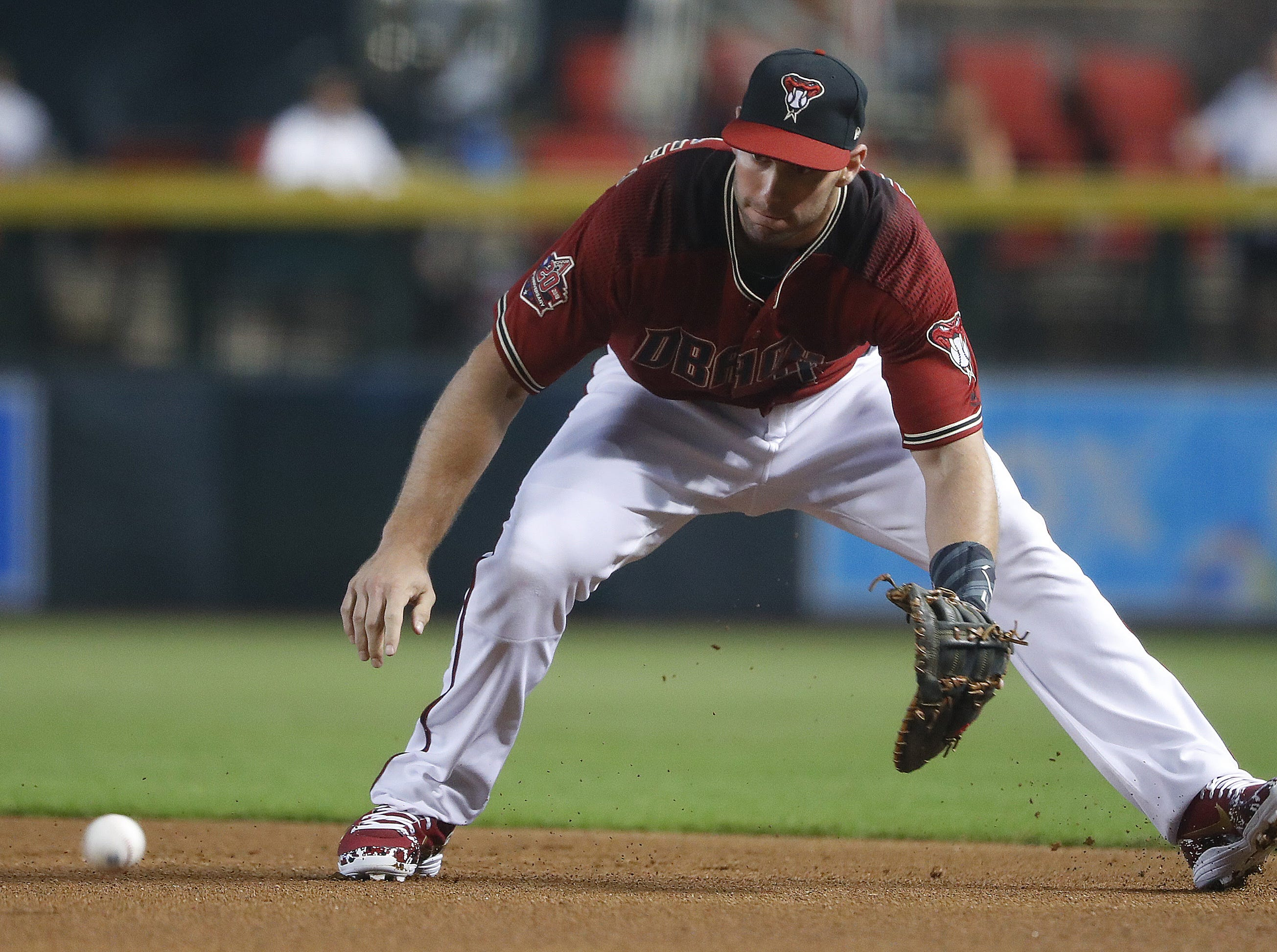 Diamondbacks Paul Goldschmidt (44) fields a groundball against the Braves during the first inning at Chase Field in Phoenix, Ariz. on Sept. 9, 2018.