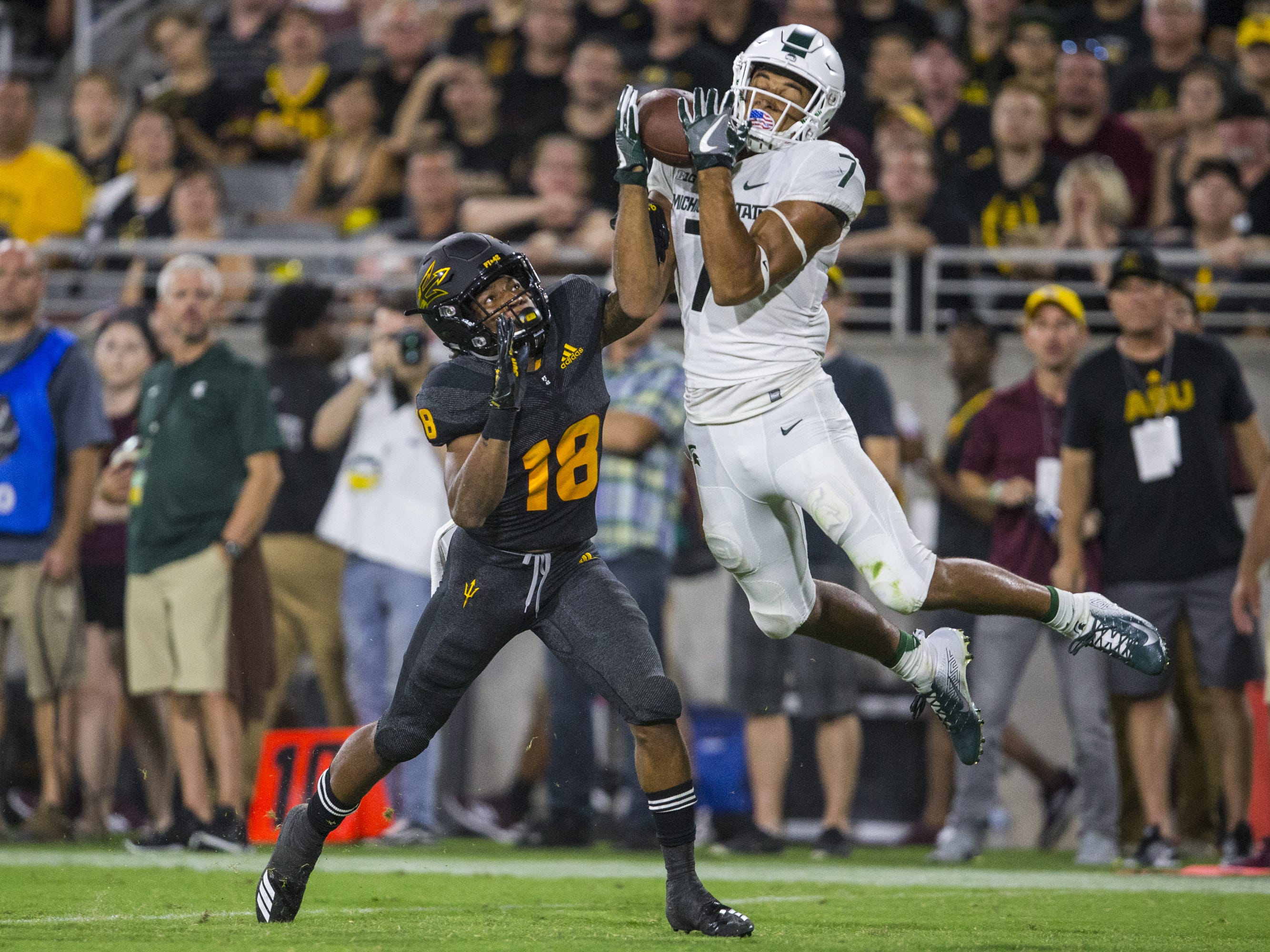 Michigan State's Cody White goes over Arizona State's Langston Frederick for a touchdown reception in the 3rd quarter on Saturday, Sept. 8, 2018, at Sun Devil Stadium in Tempe, Ariz.